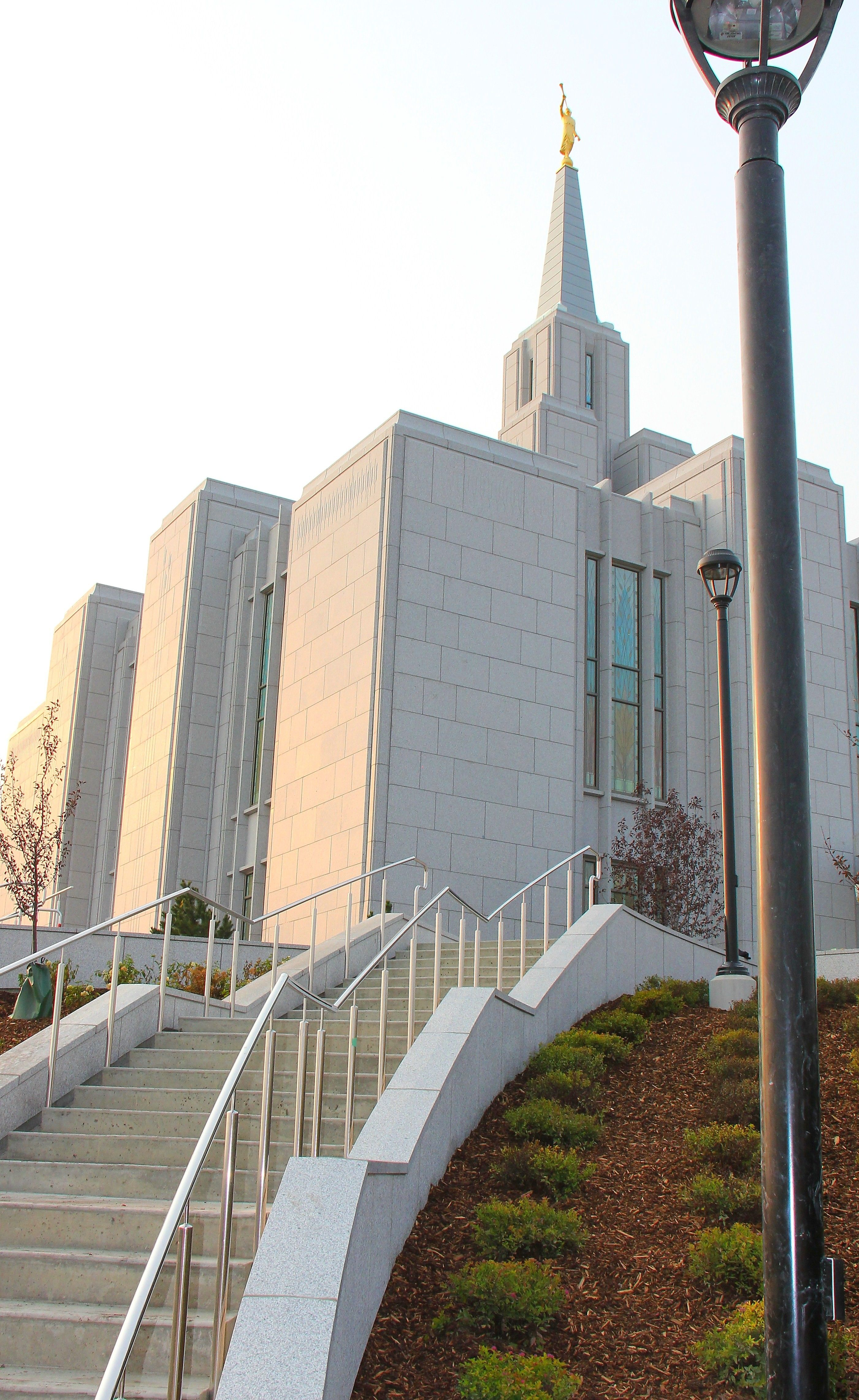 Stairs ascend from the temple grounds and lead to the entrance of the Calgary Alberta Temple.