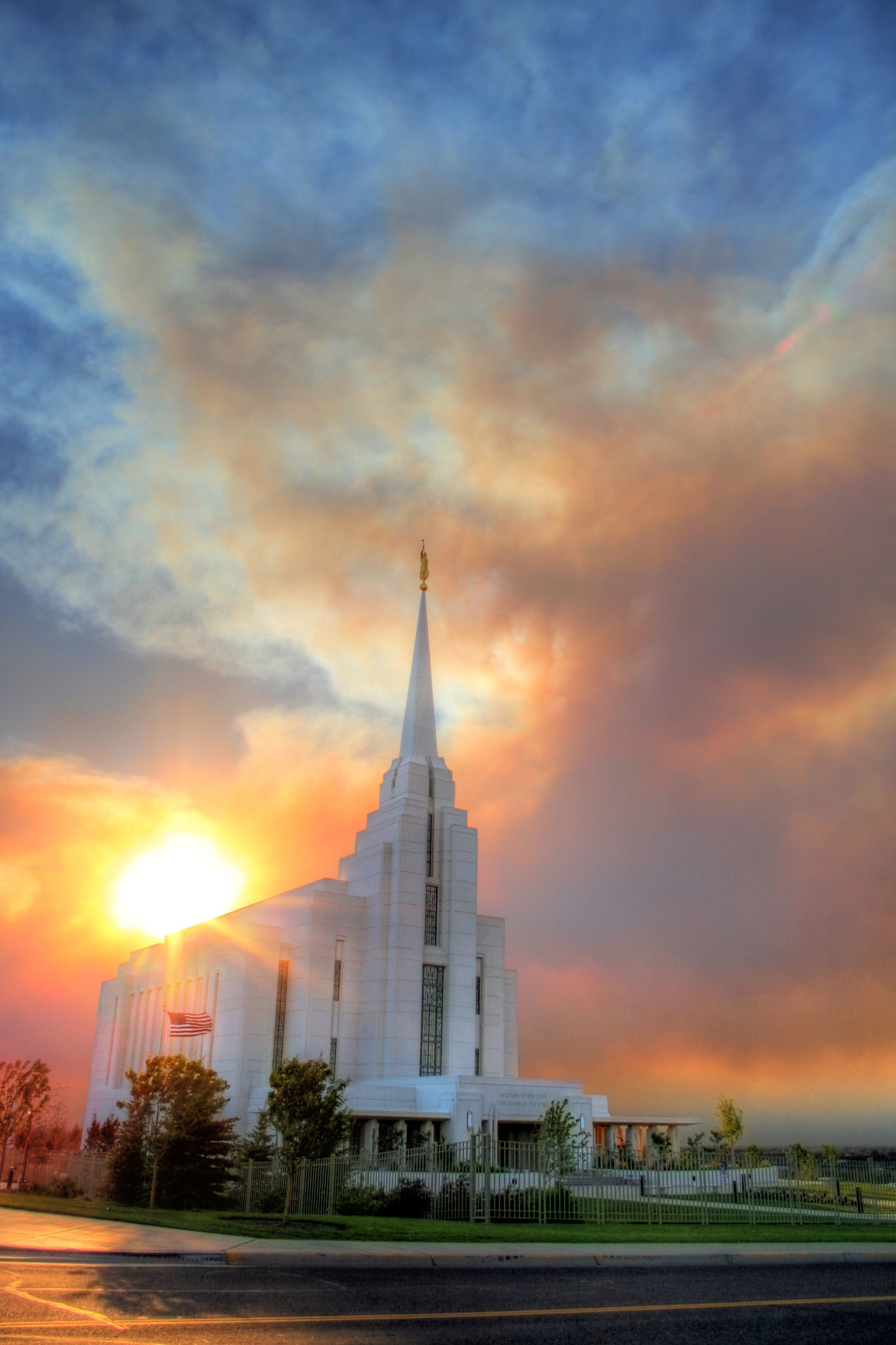 The Rexburg Idaho Temple at sunset, including clouds and scenery.