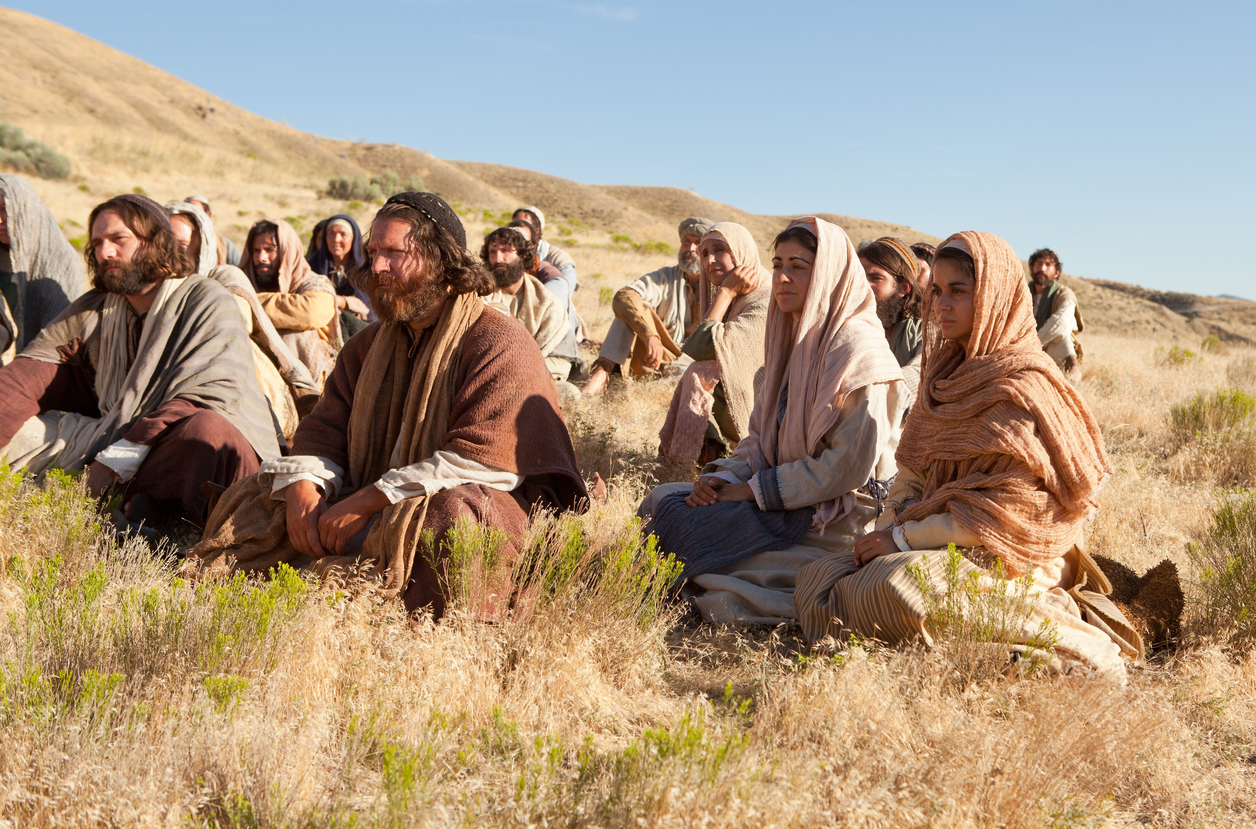 Listeners sit around Jesus as He teaches of the higher law.