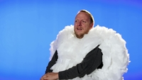 A man dressed as a cloud is interviewed