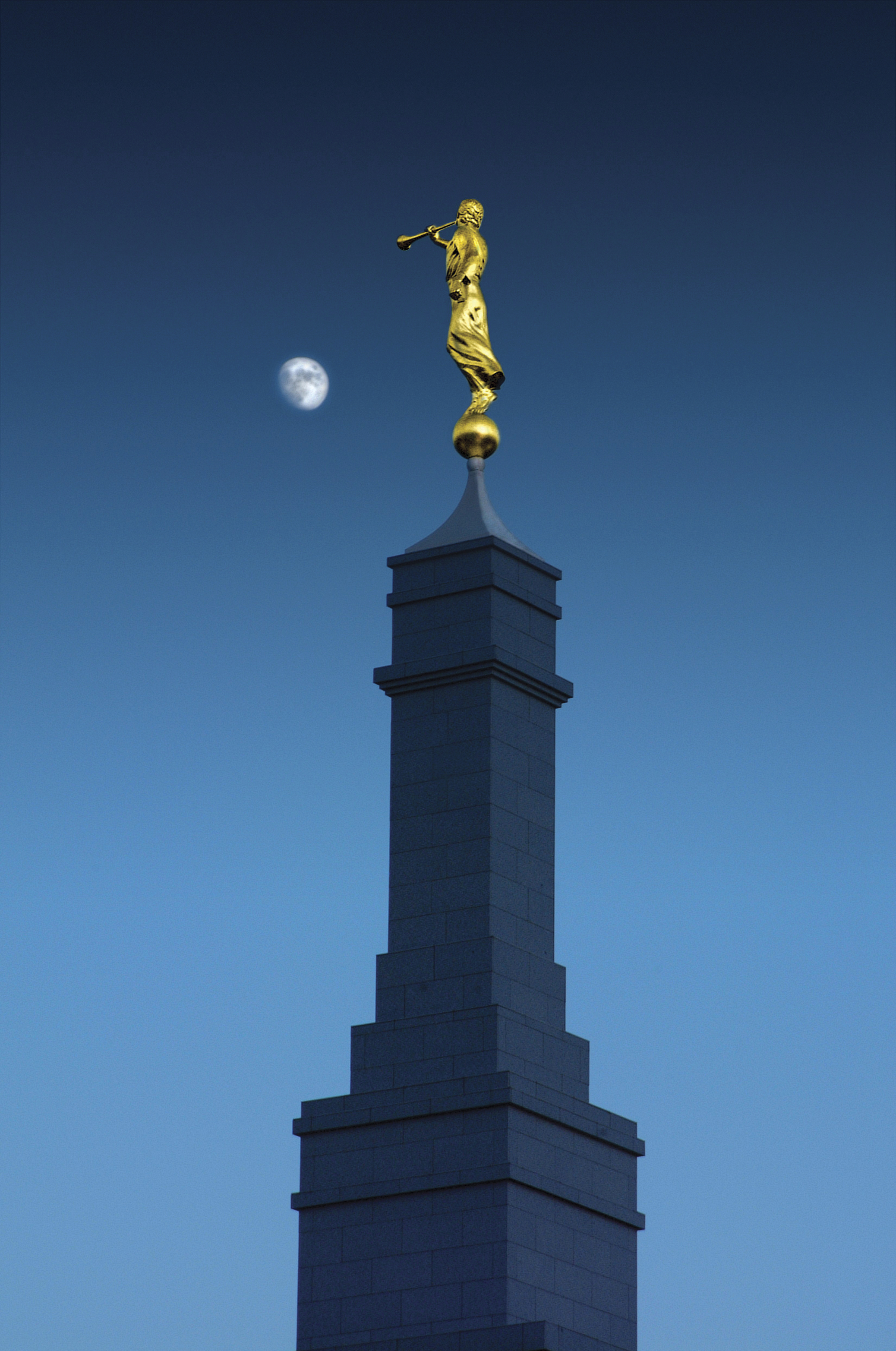 A view of the spire of the Fresno California Temple at night, with the angel Moroni on top.
