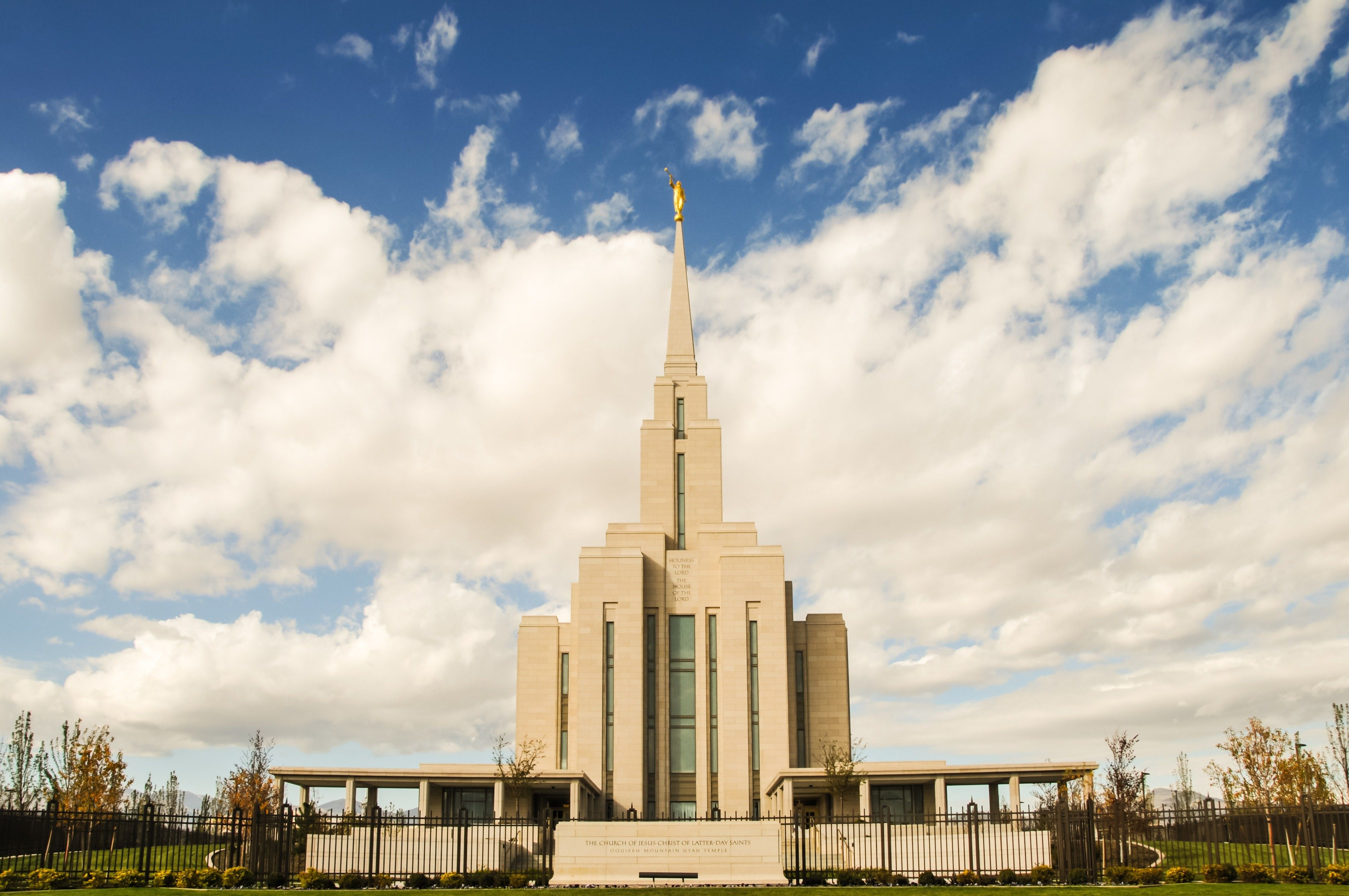 The entire Oquirrh Mountain Utah Temple, including the entrance, name sign, and scenery.