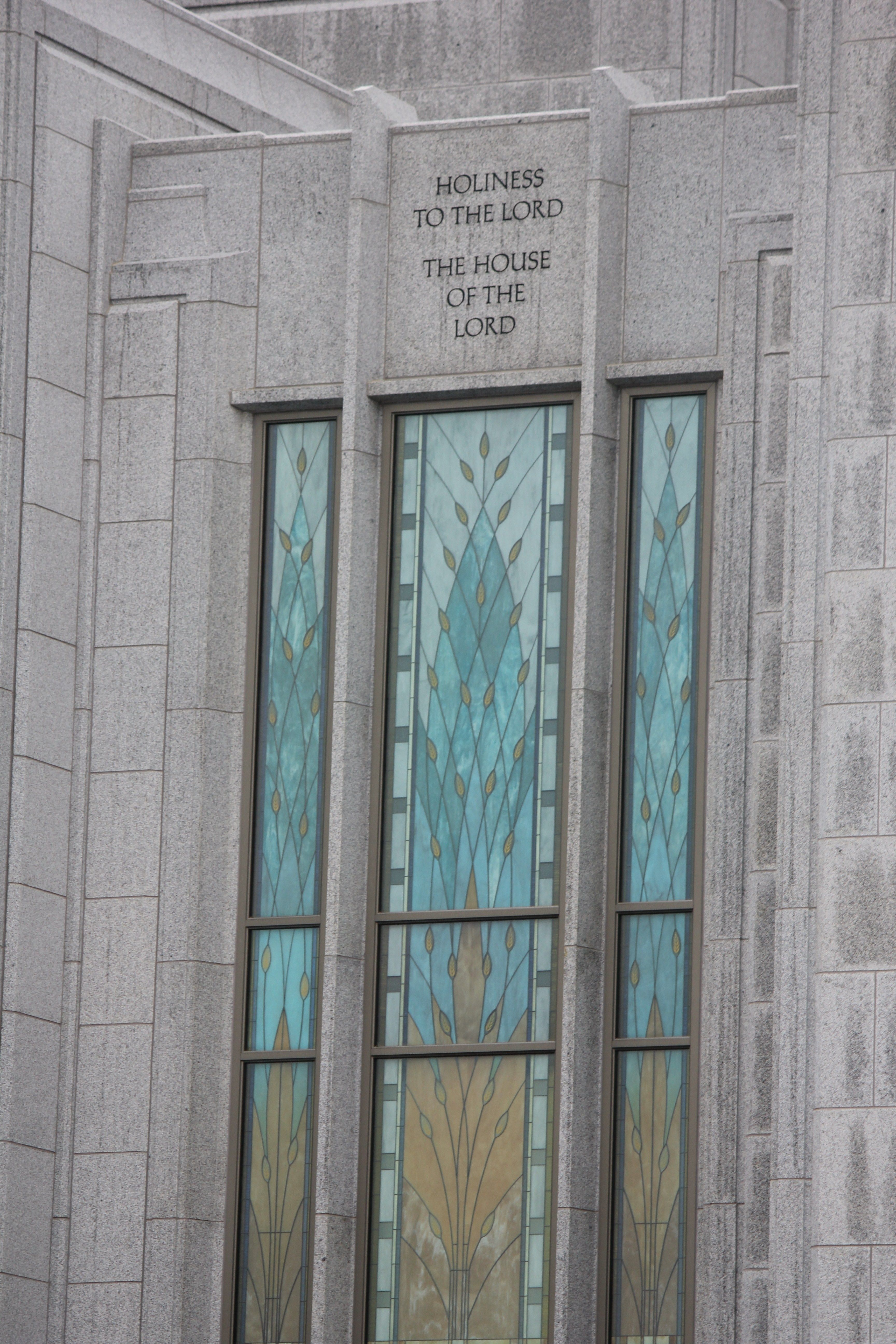 """The inscription """"Holiness to the Lord: The House of the Lord"""" is written above a window of the Calgary Alberta Temple."""