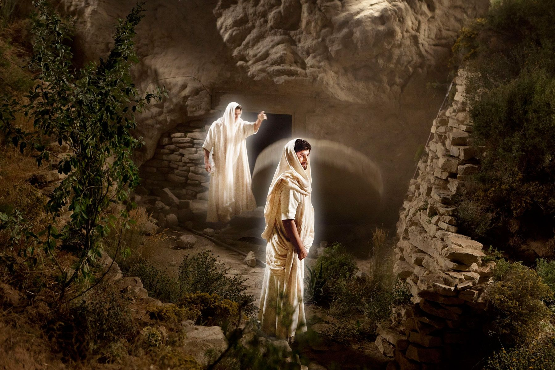 Angels come down and open the tomb where Christ's body lays.