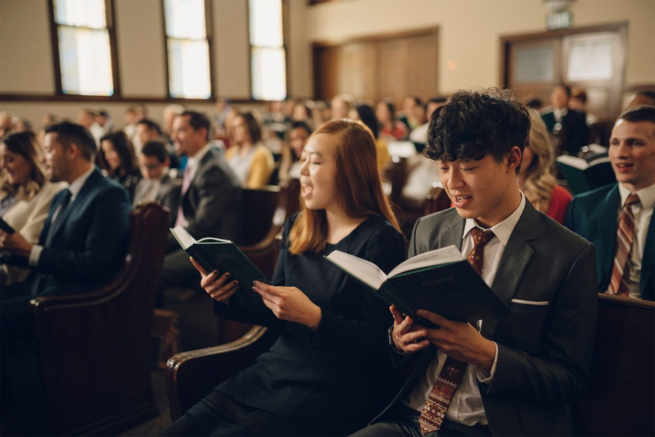 A congregation sing together in a chapel