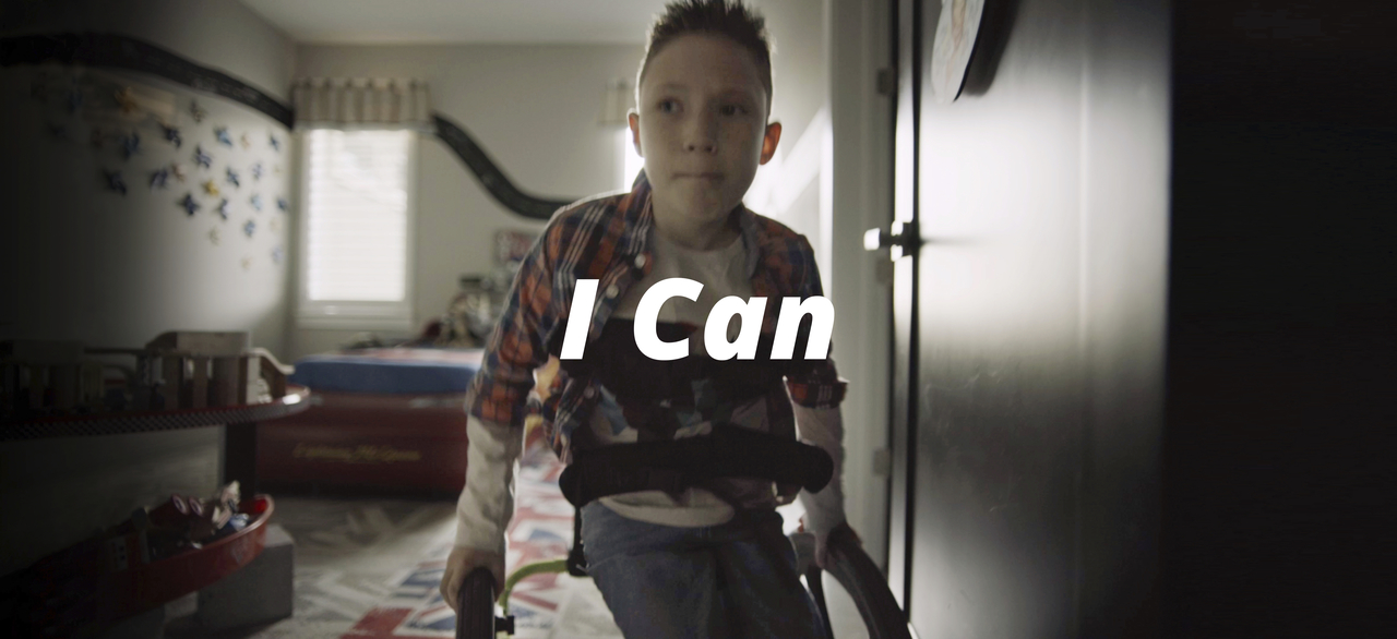 A young boy in a wheel chair finds strength in the Bible passage Philippians 4:11–13