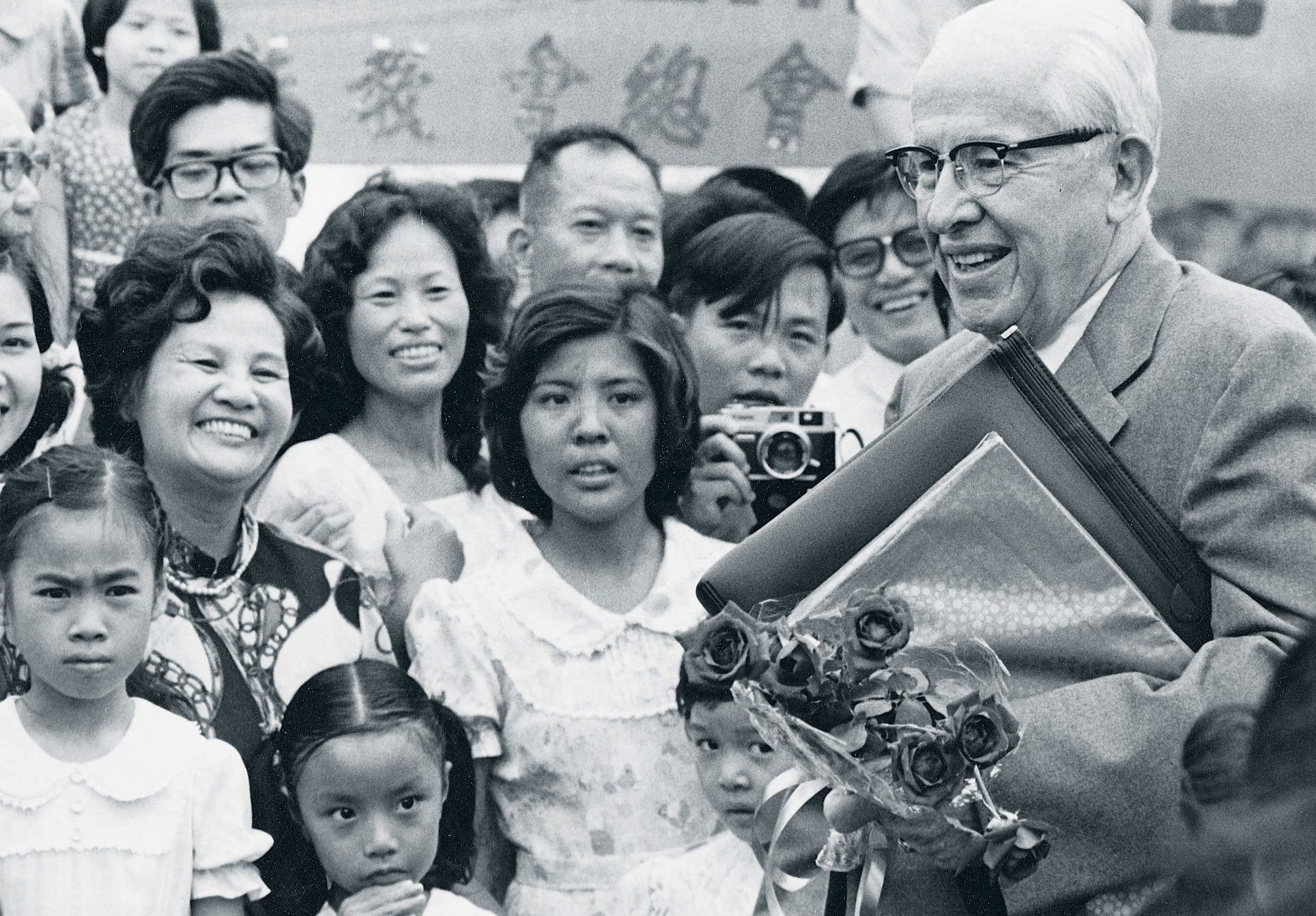 President Benson standing with members in Taiwan, around 1980.