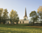 A side view of the Helsinki Finland Temple, seen at the top of a hill in the warm light of sunset.