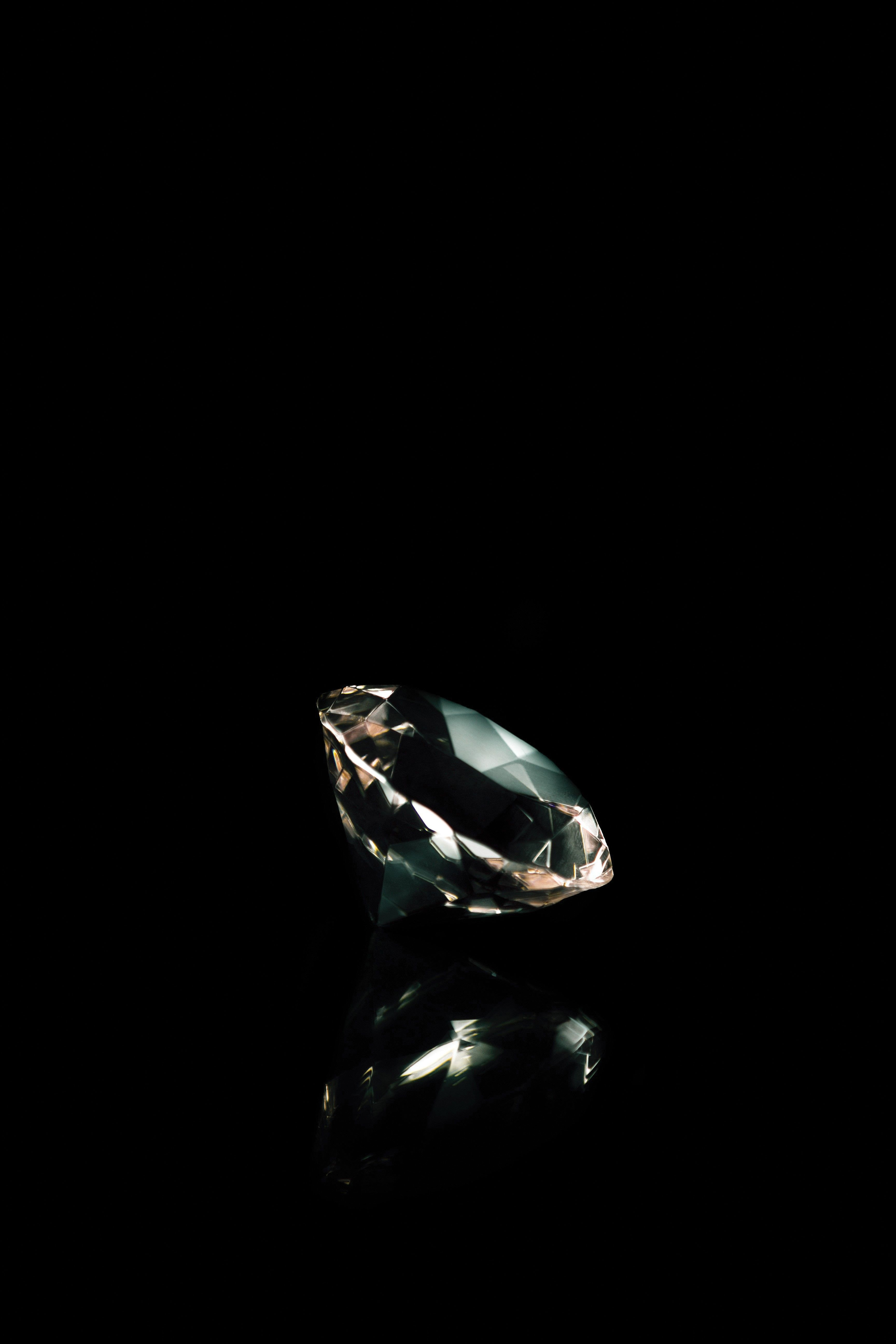 A diamond photographed against a black background.