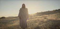 Jesus Christ walking through a field