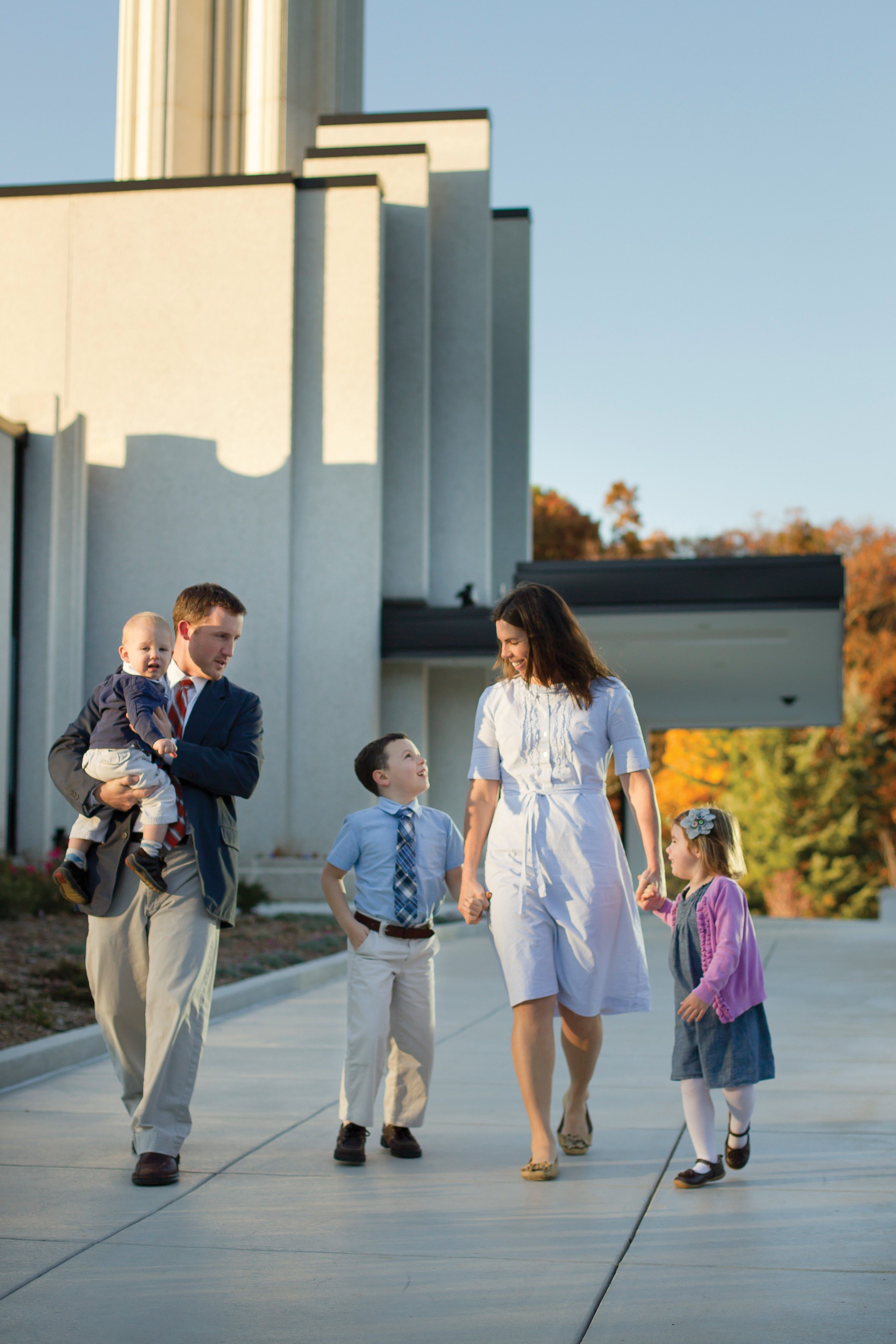 A family walks on the temple grounds together.