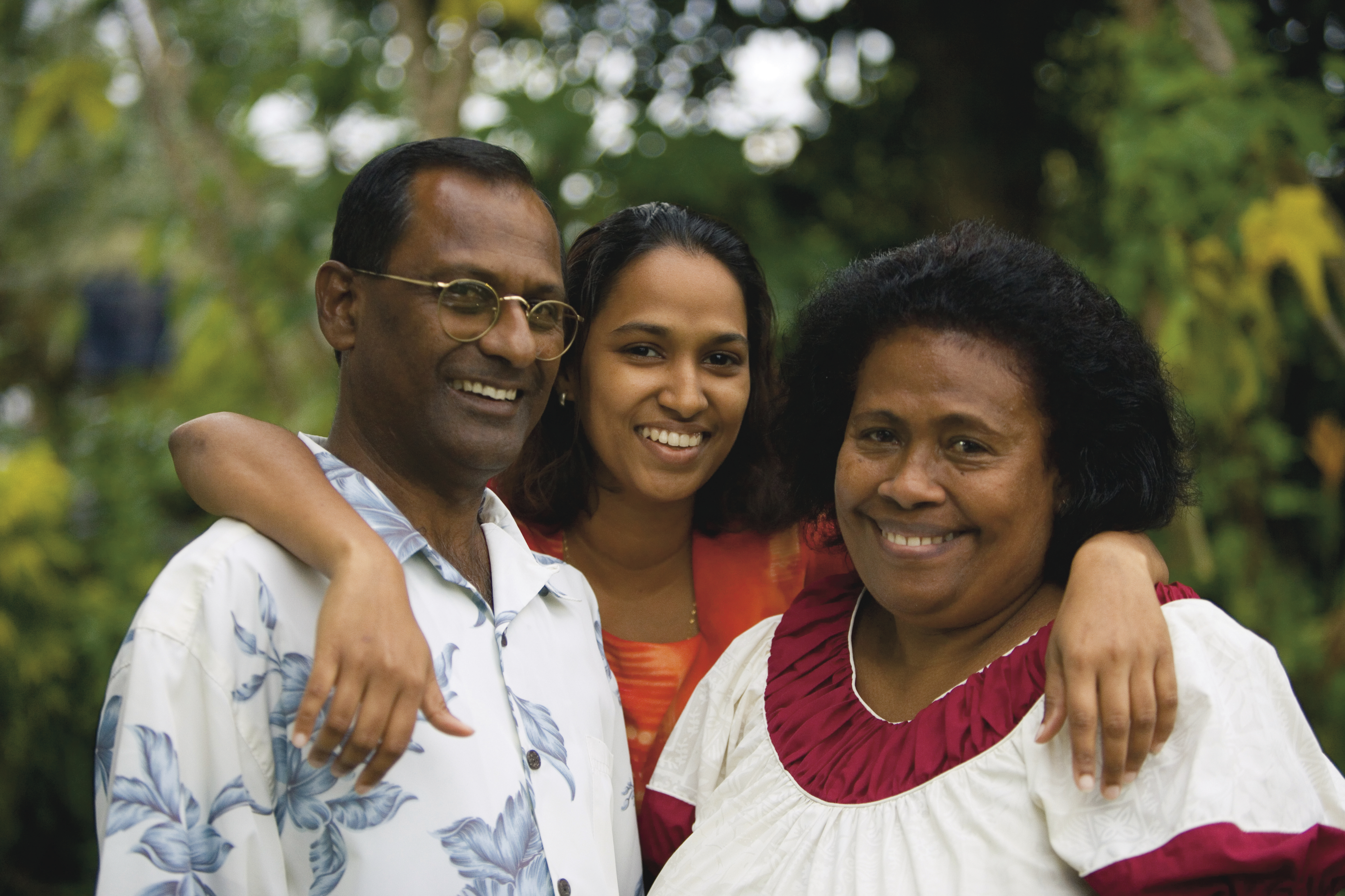 A portrait of a couple with their daughter in Fiji.