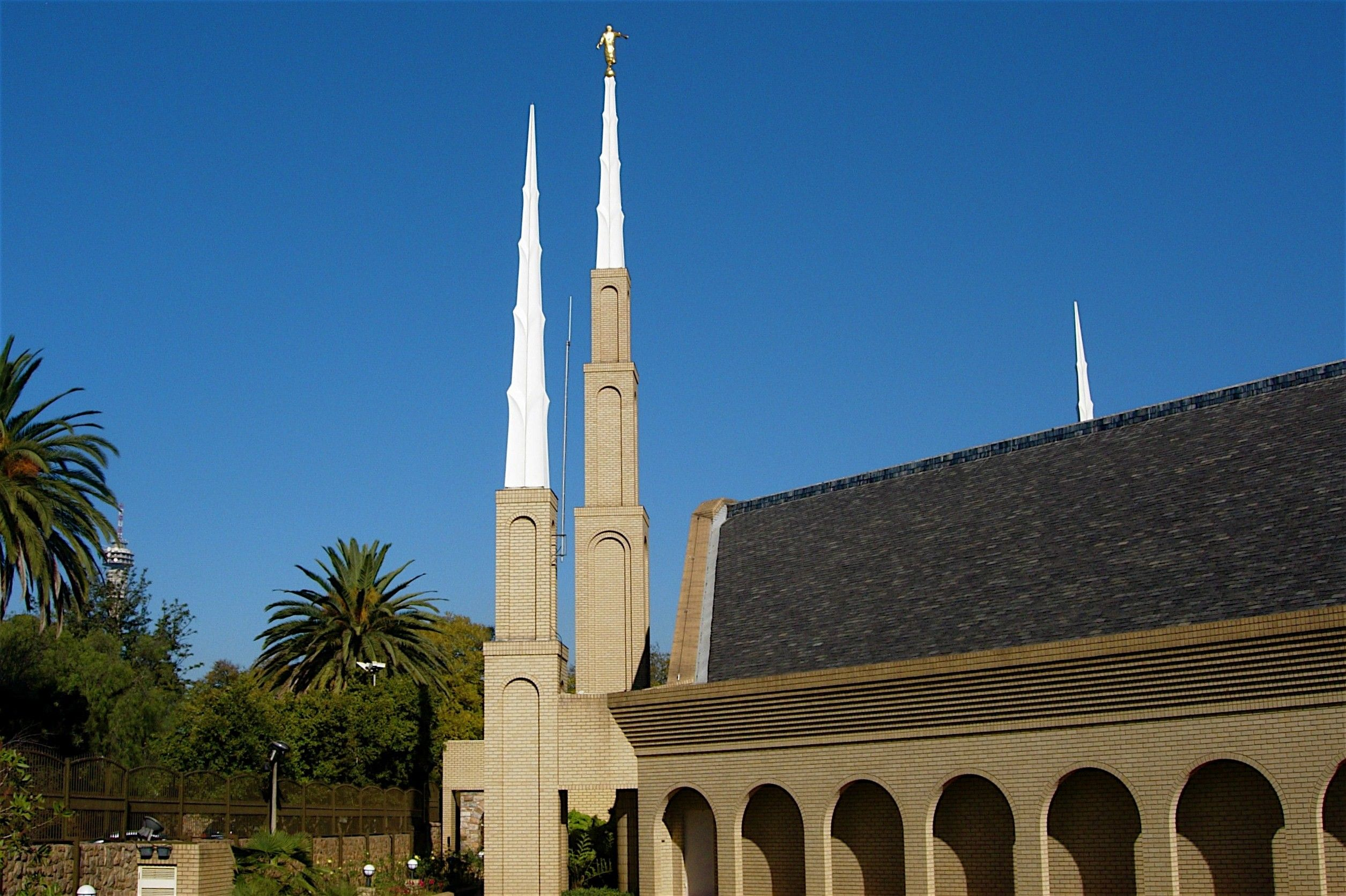 The Johannesburg South Africa Temple spires, including a side view of the temple and scenery.