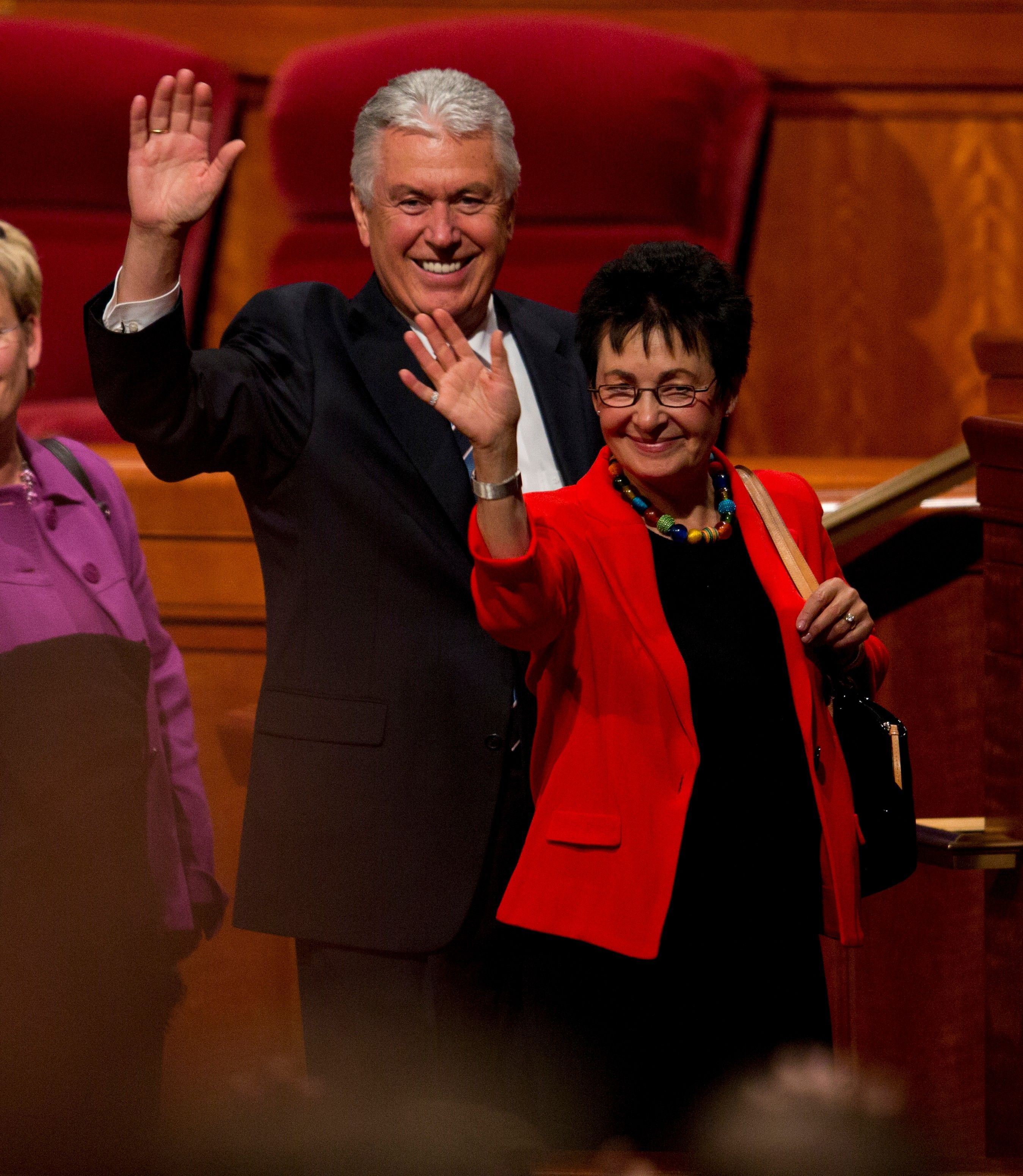 Dieter and Harriet Uchtdorf waving to the congregation in the Conference Center.