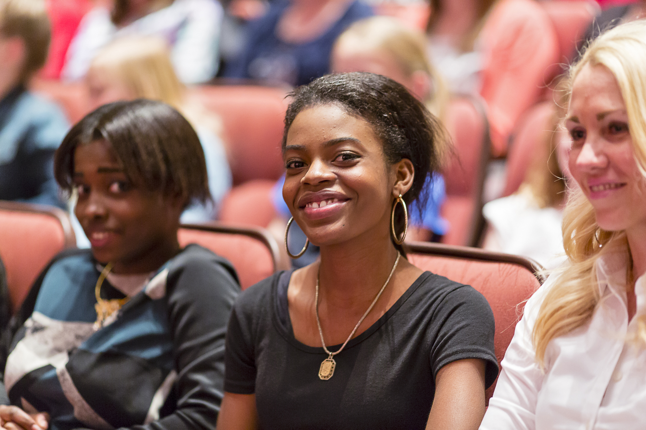 Three young women attend general conference at the Conference Center in Salt Lake City.