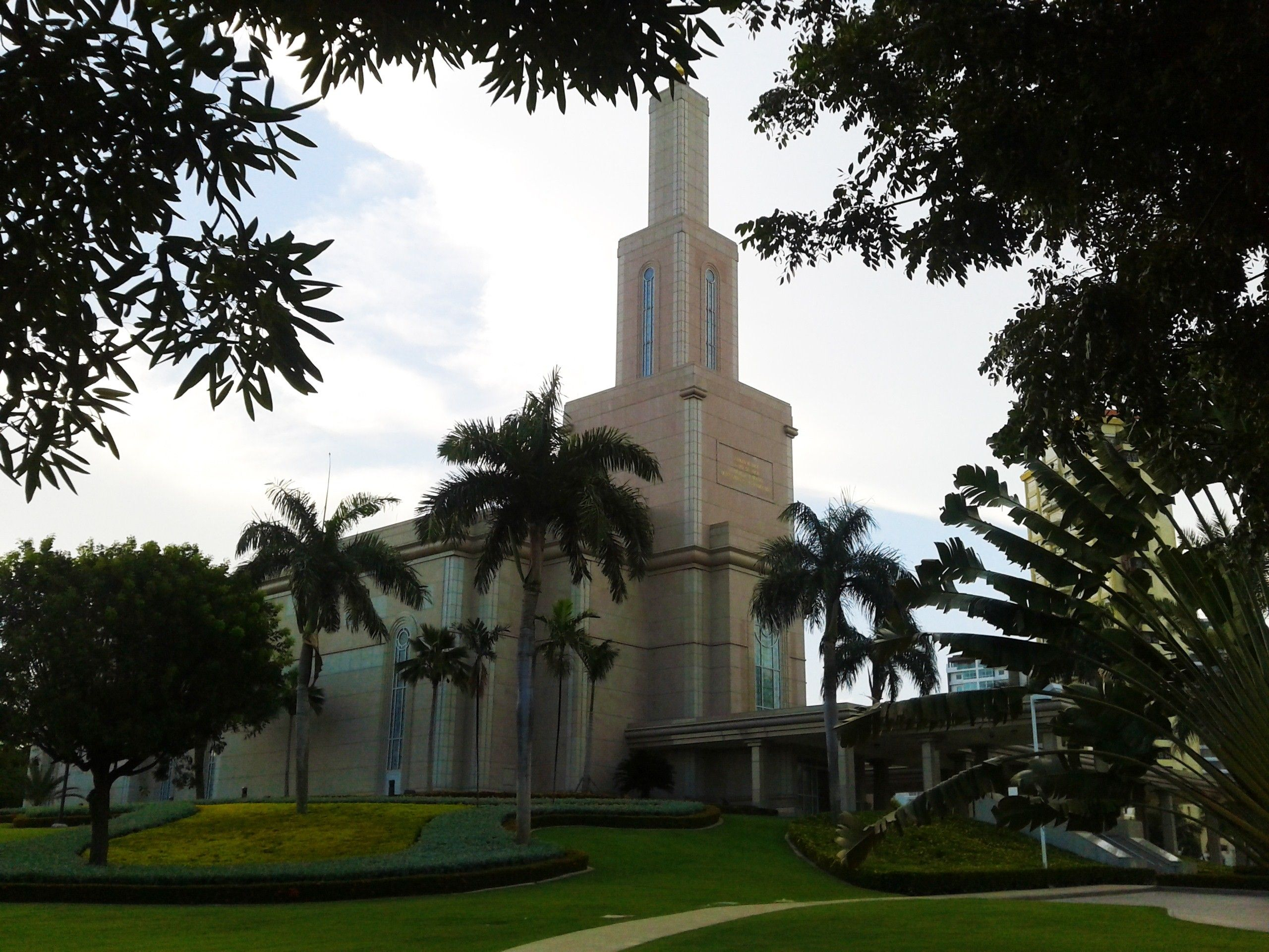 The Santo Domingo Dominican Republic Temple side view, including the scenery and entrance.