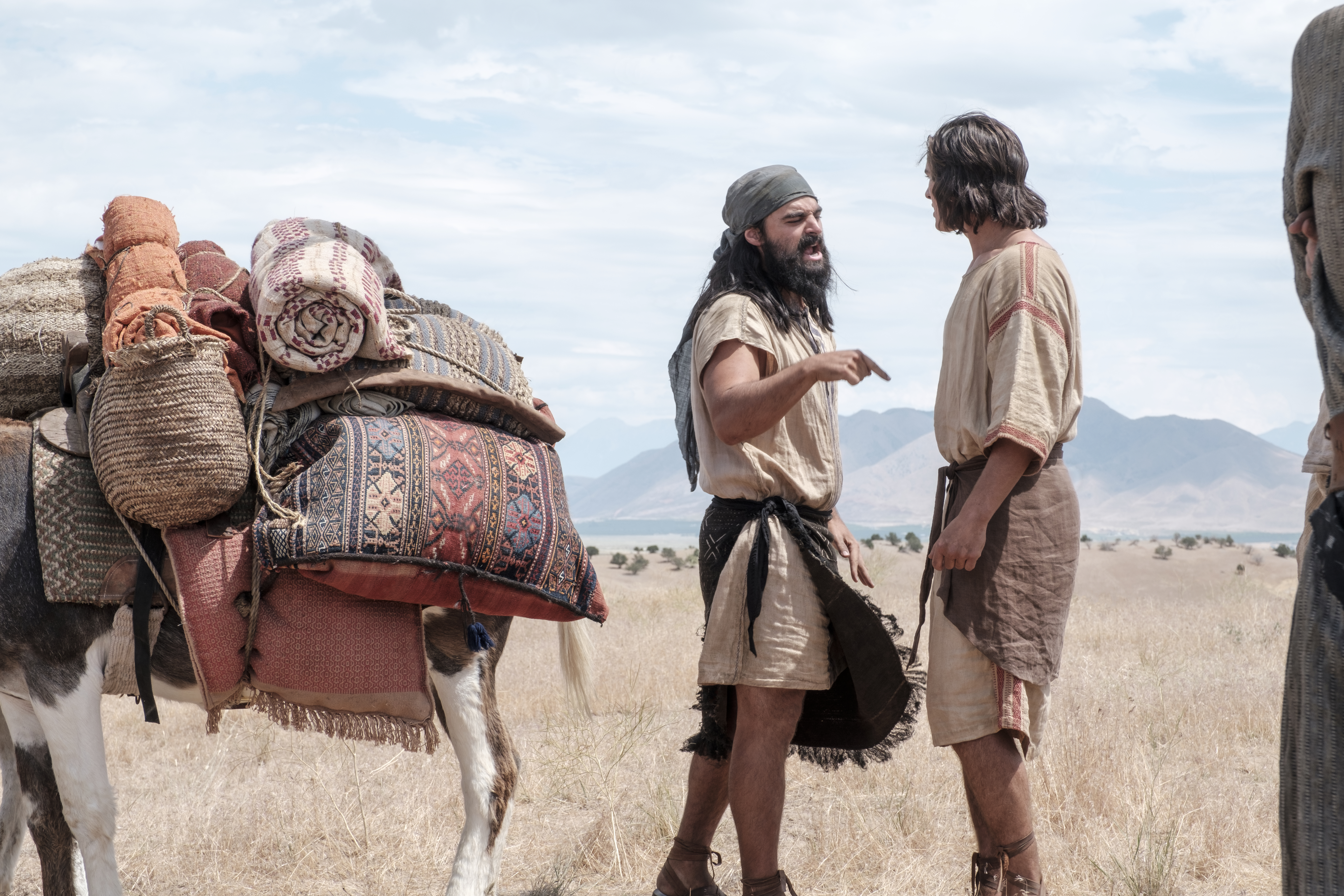 Laman and Nephi argue in the wilderness.