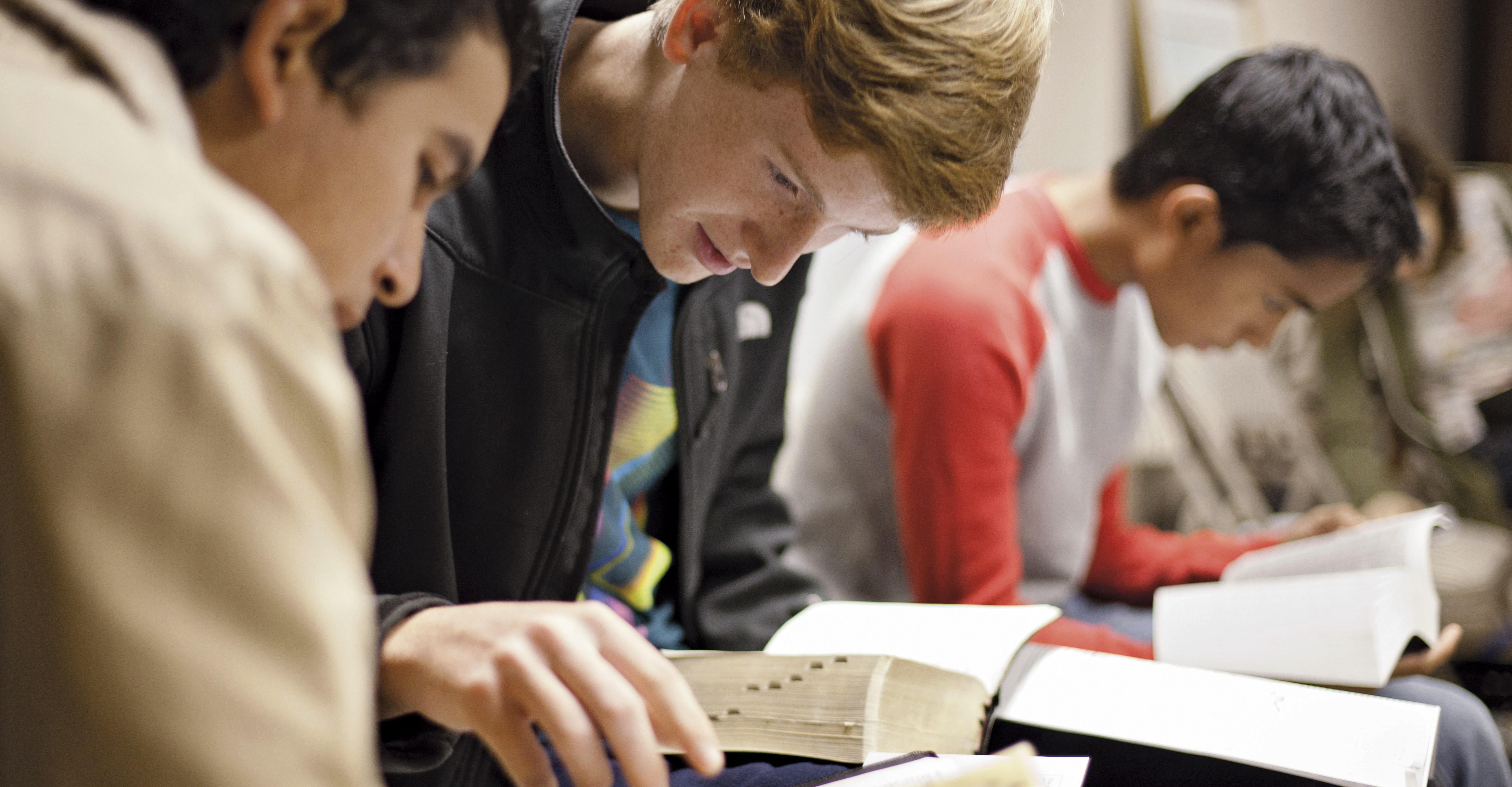 Youth studying the scriptures in their seminary class.