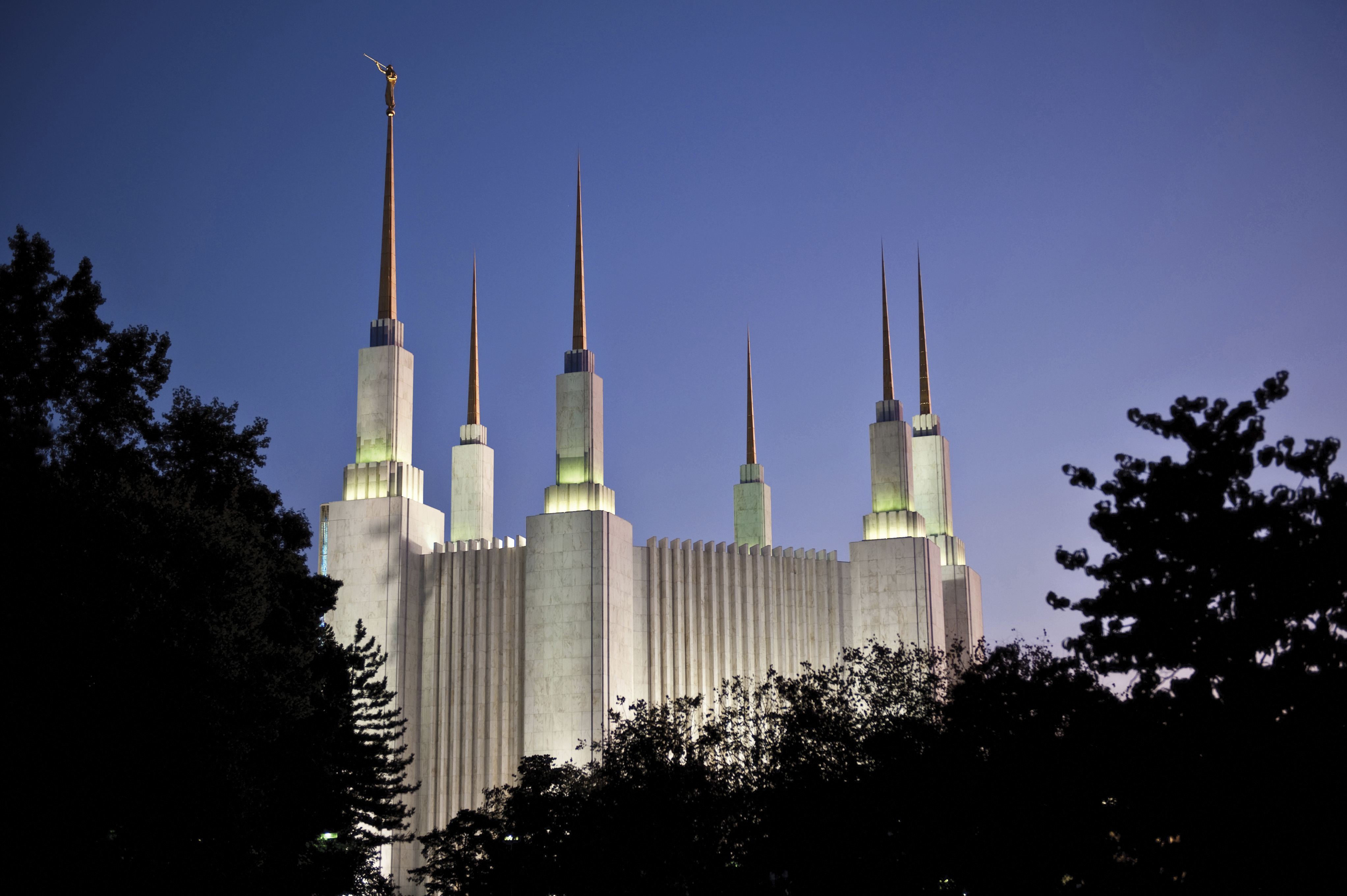The Washington D.C. Temple in the evening, with scenery.