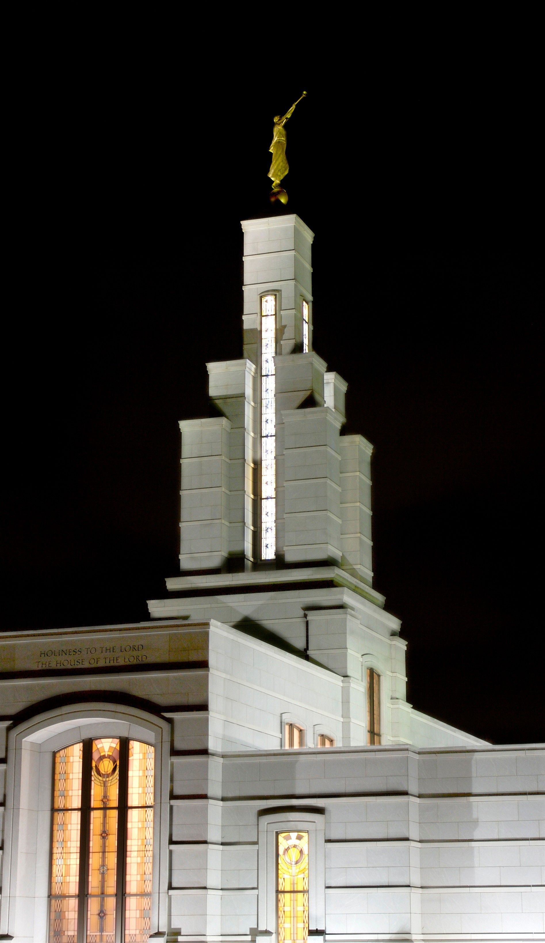 Lights shine on the Accra Ghana Temple at night.