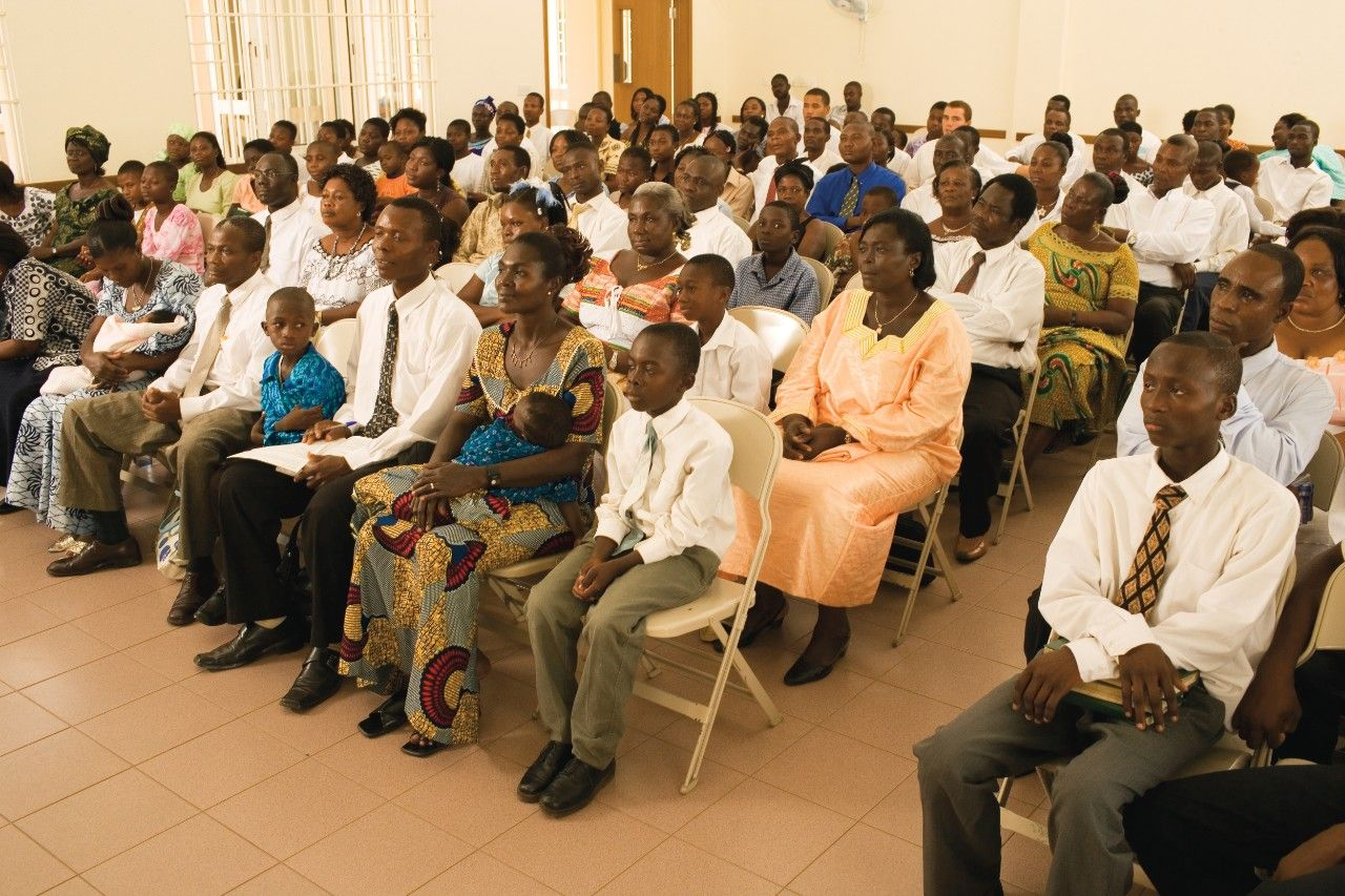 A congregation listening to a speaker during sacrament meeting.