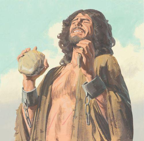man holding rock
