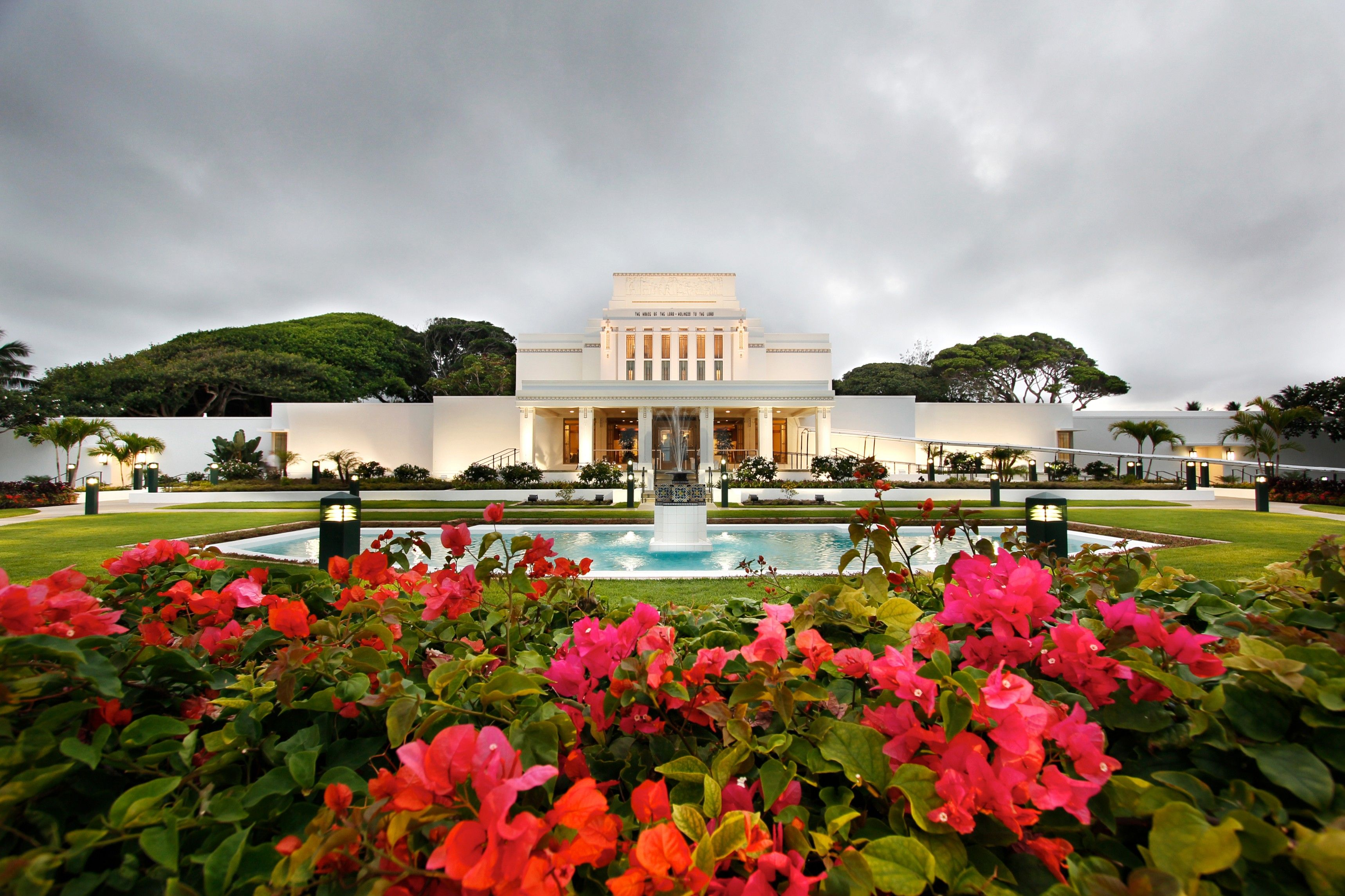 The Laie Hawaii Temple entrance, including a pond and scenery.