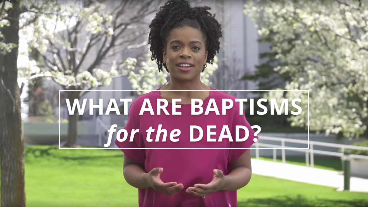 A woman stands outside a temple in spring and explains the purpose of baptisms for the dead