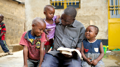 Father reading scriptures