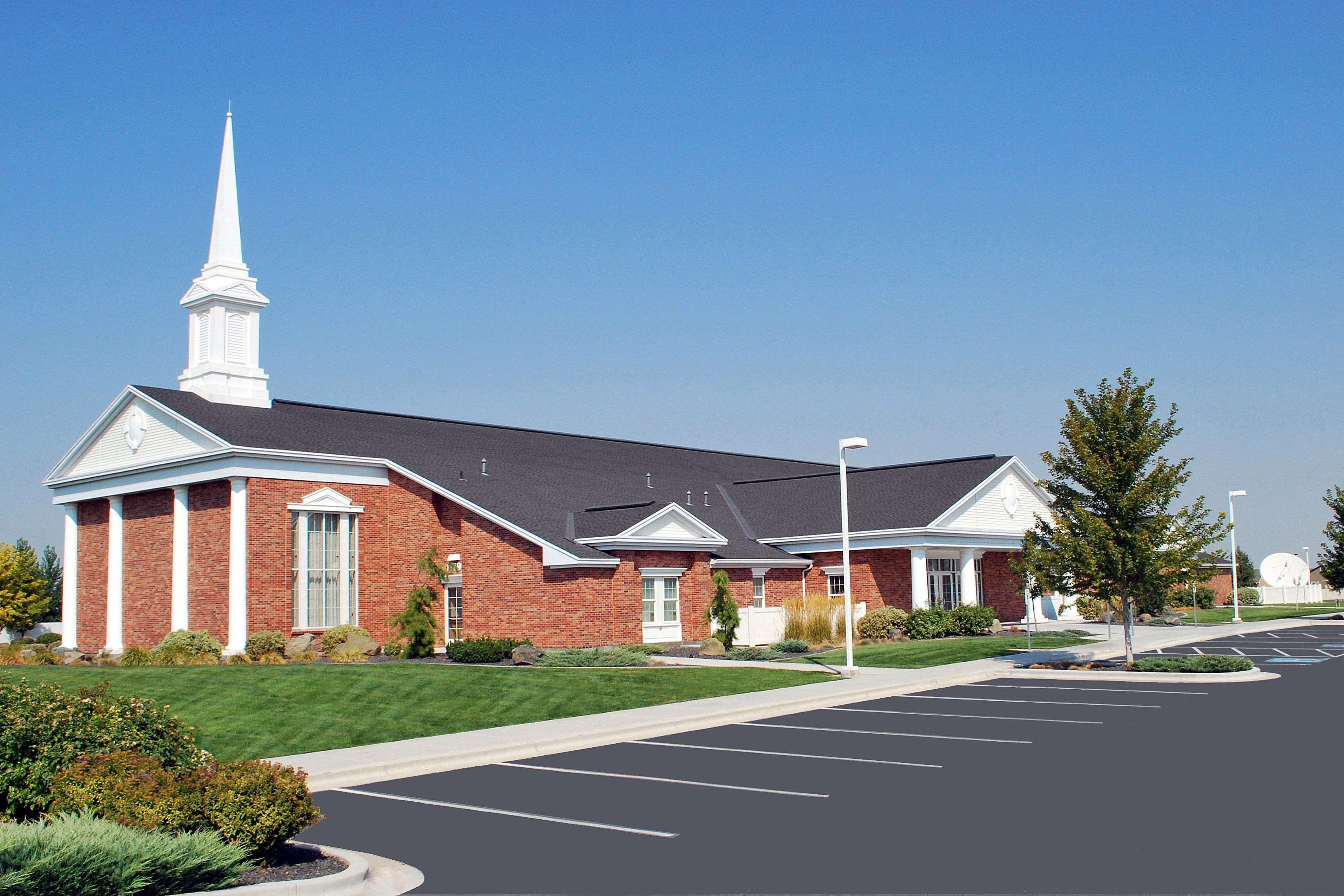A side view of a chapel and parking lot in Caldwell, Idaho.