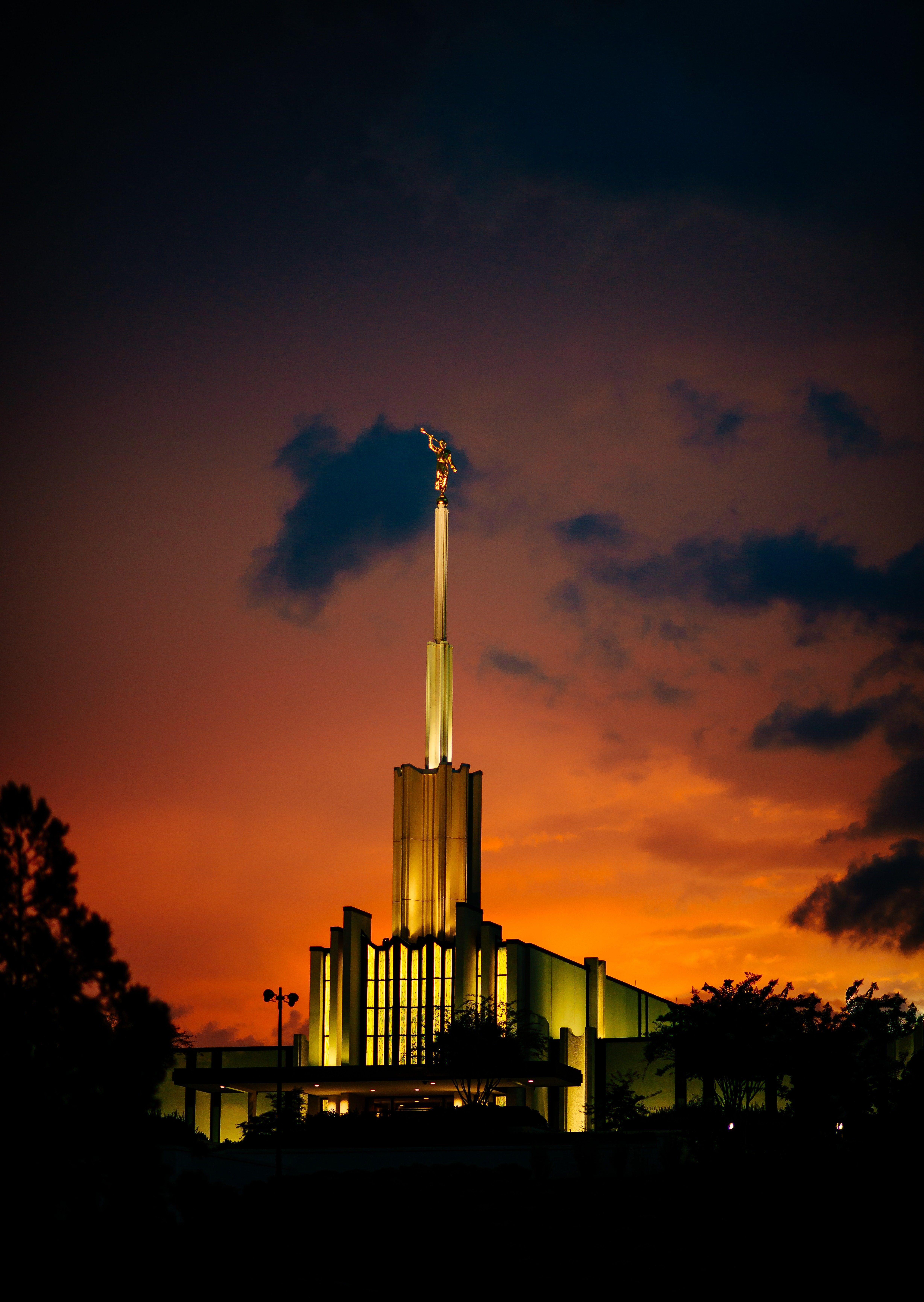 The Atlanta Georgia Temple is lit up at night.