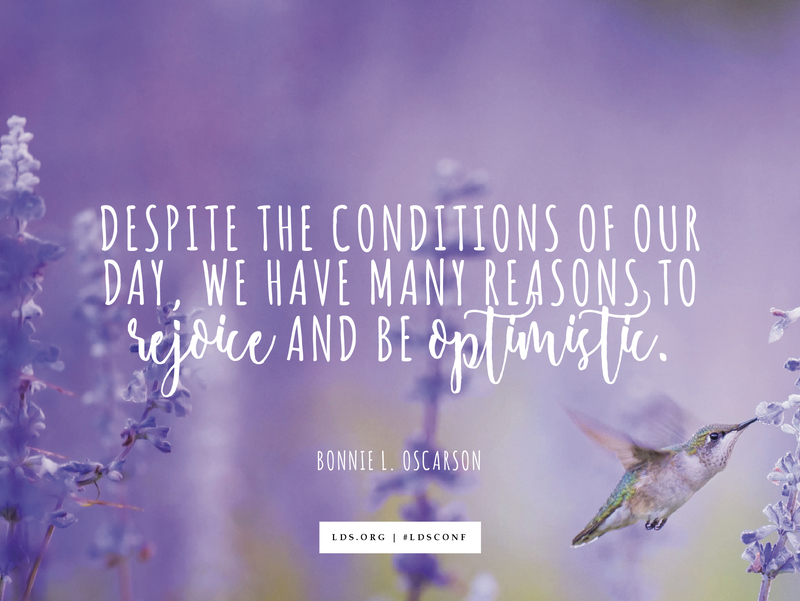 """An image of a hummingbird feeding in a field of purple flowers, overlaid with a quote by Sister Bonnie L. Oscarson: """"Despite the conditions of our day, we have many reasons to rejoice and be optimistic."""""""