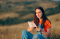 Young Woman Reading a Note