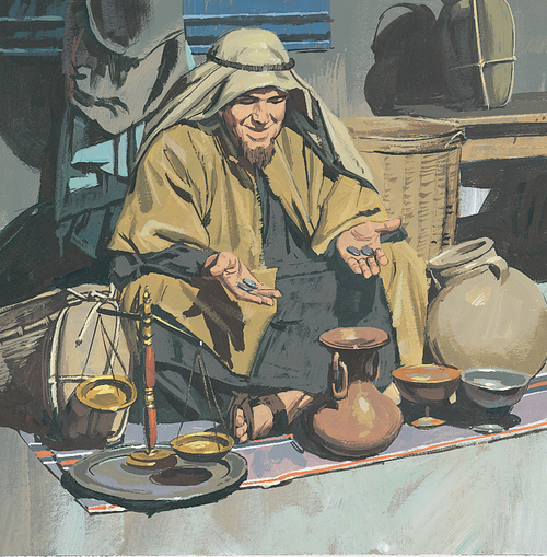 man weighing money