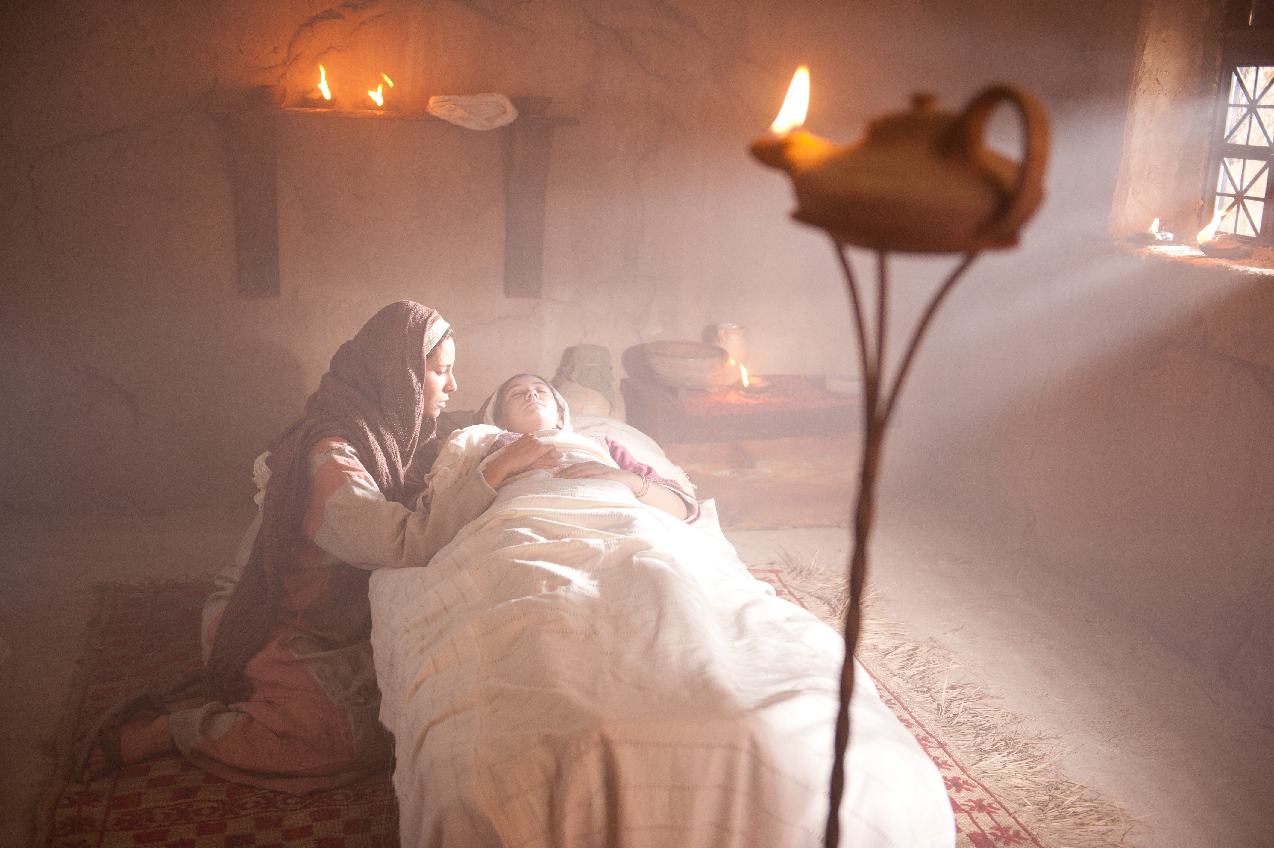The daughter of Jairus lays as if she were dead.