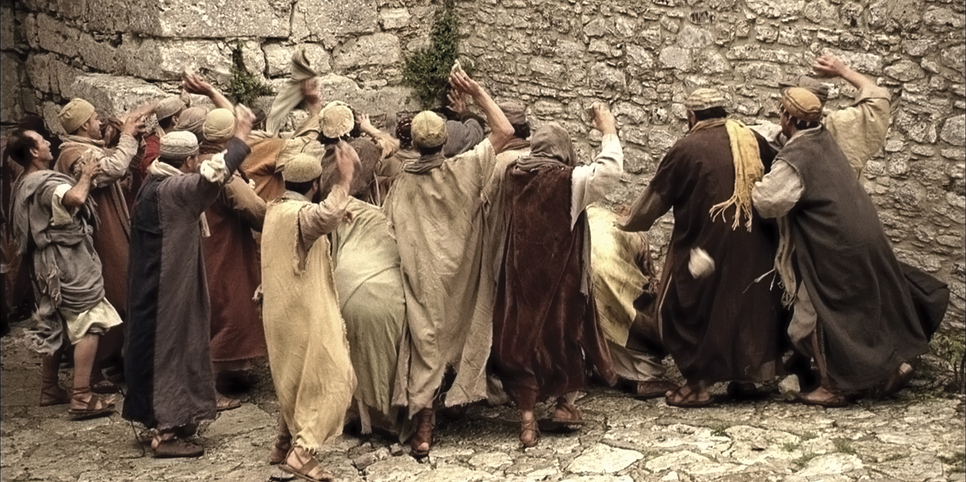 Men upset by Paul's teachings stone him.