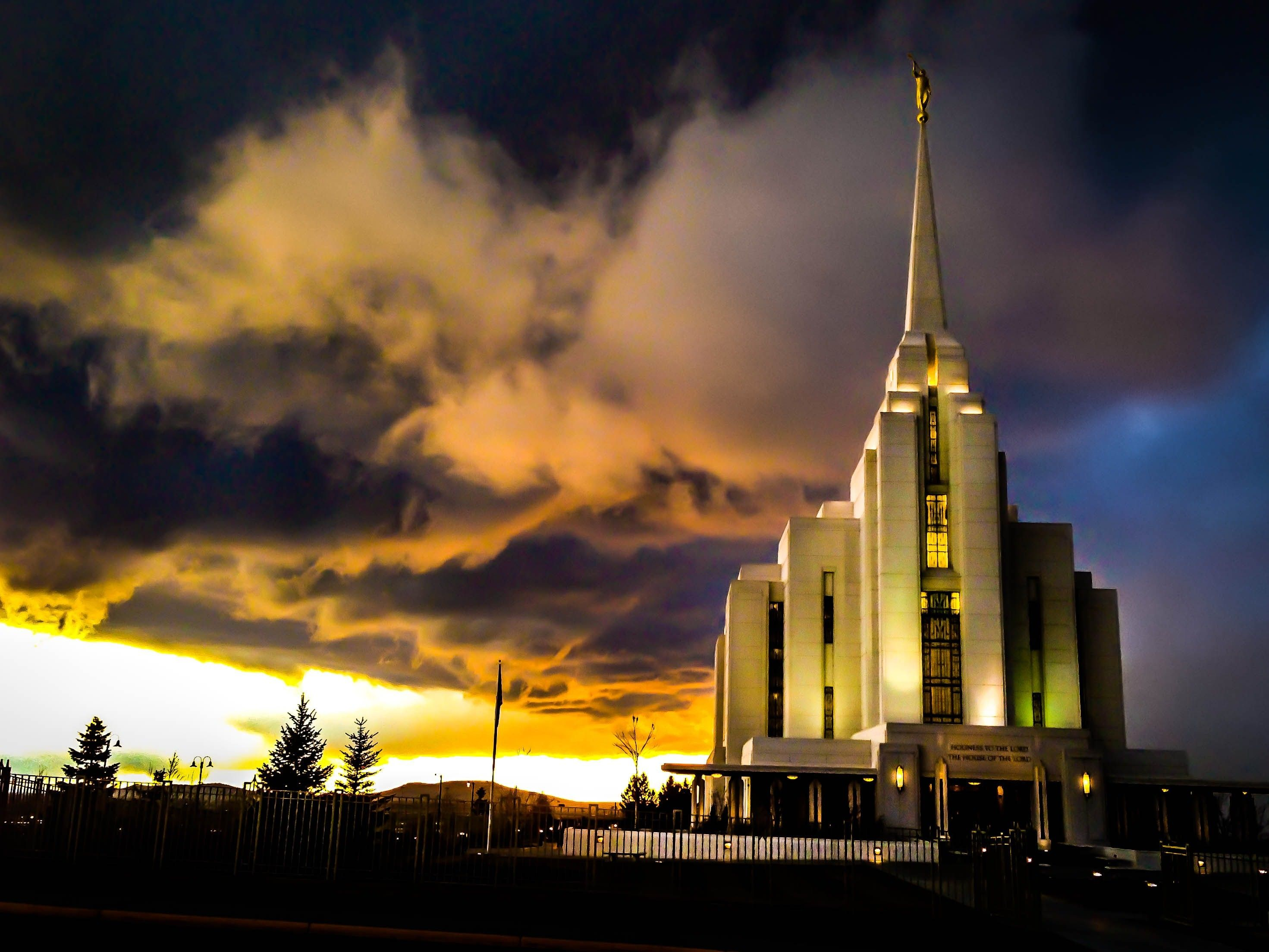 The Rexburg Idaho Temple at sunset, including the entrance and scenery.