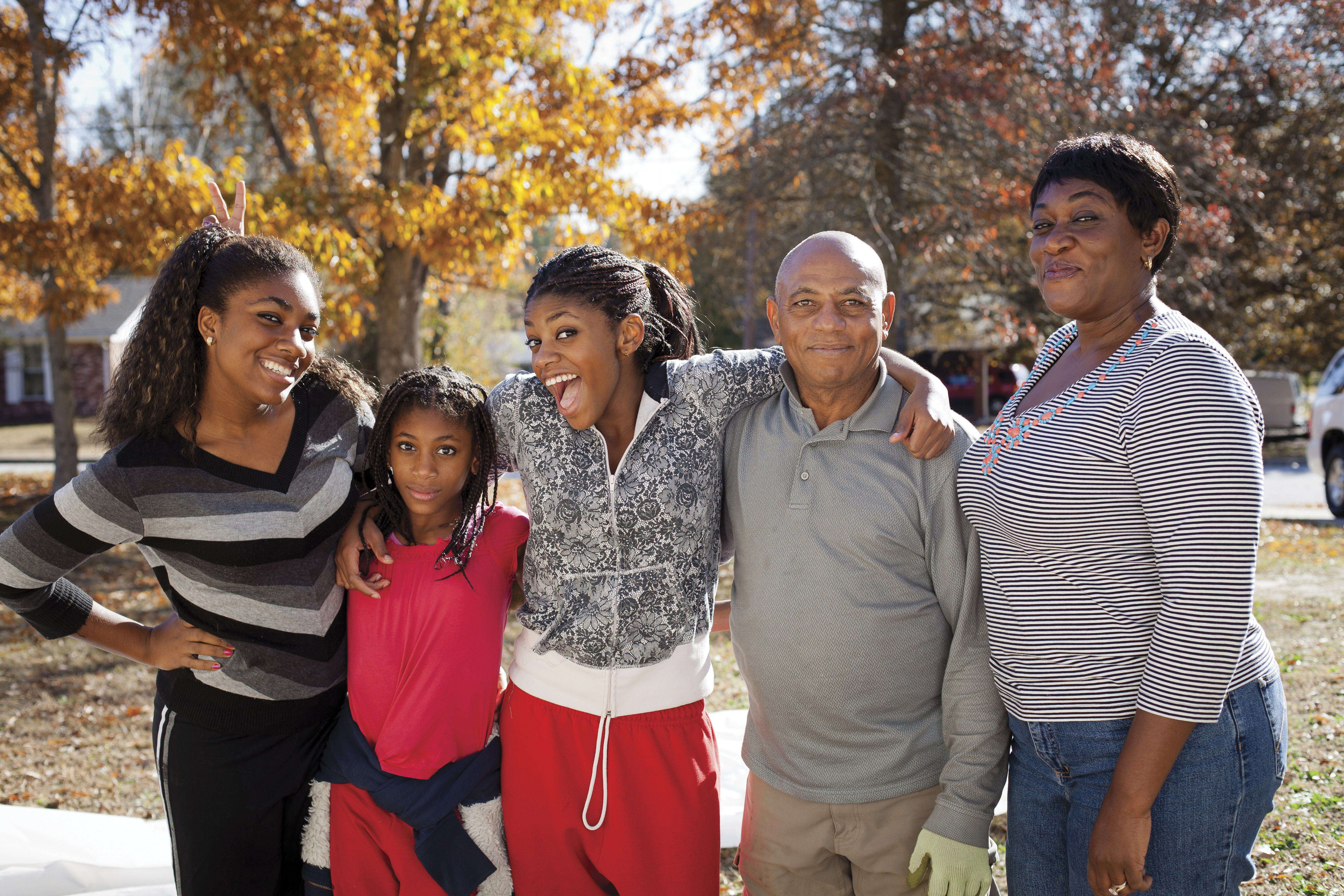 A mother, father, and three daughters.