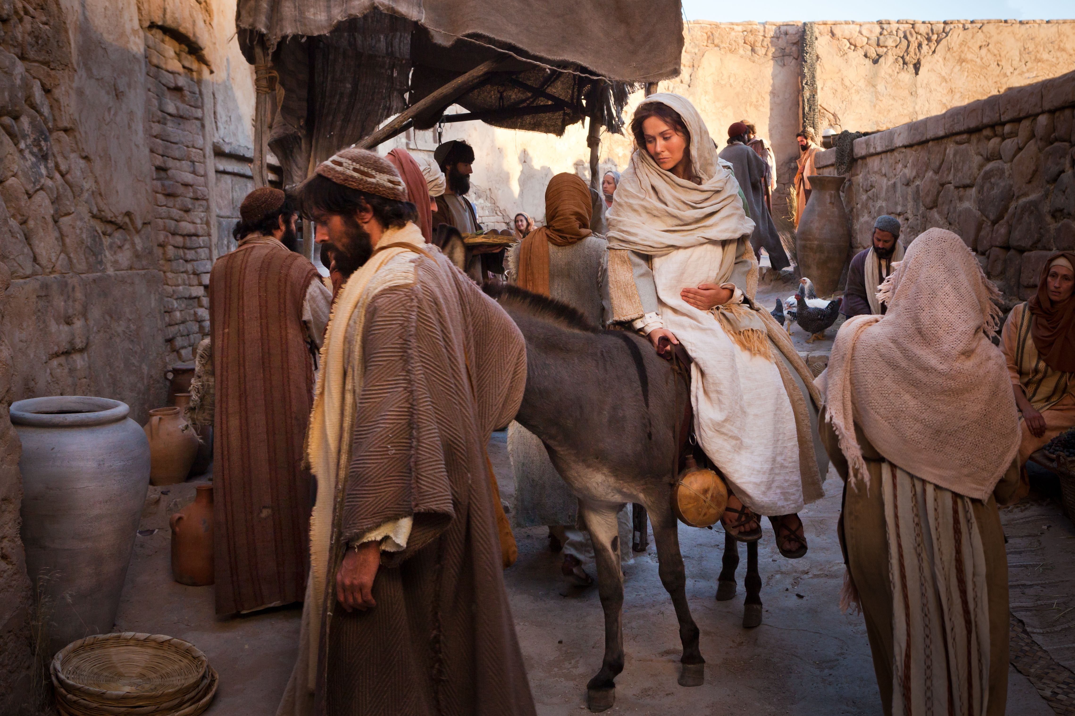 Mary and Joseph enter Bethlehem and begin searching for an inn.