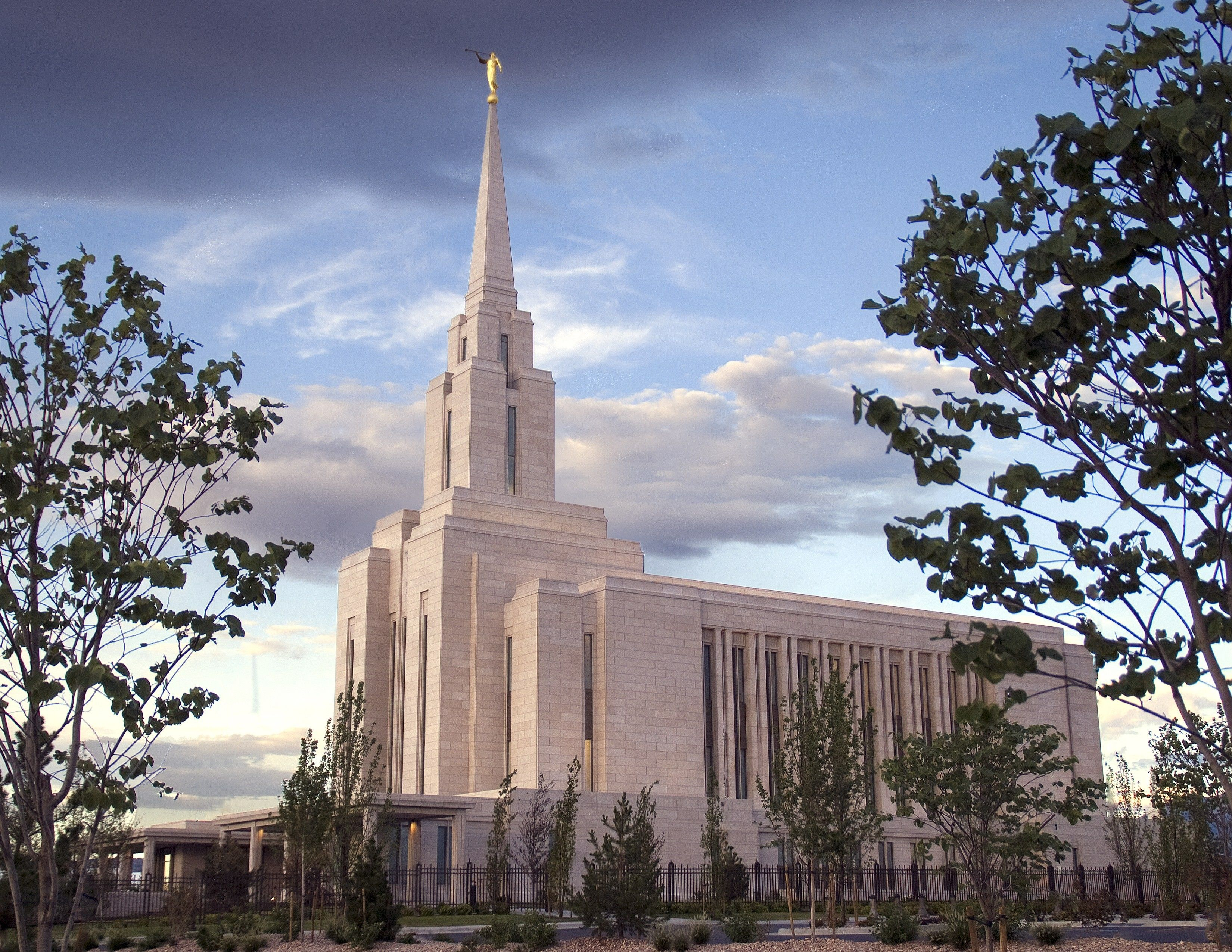 The Oquirrh Mountain Utah Temple side view at sunset, including the entrance and scenery.