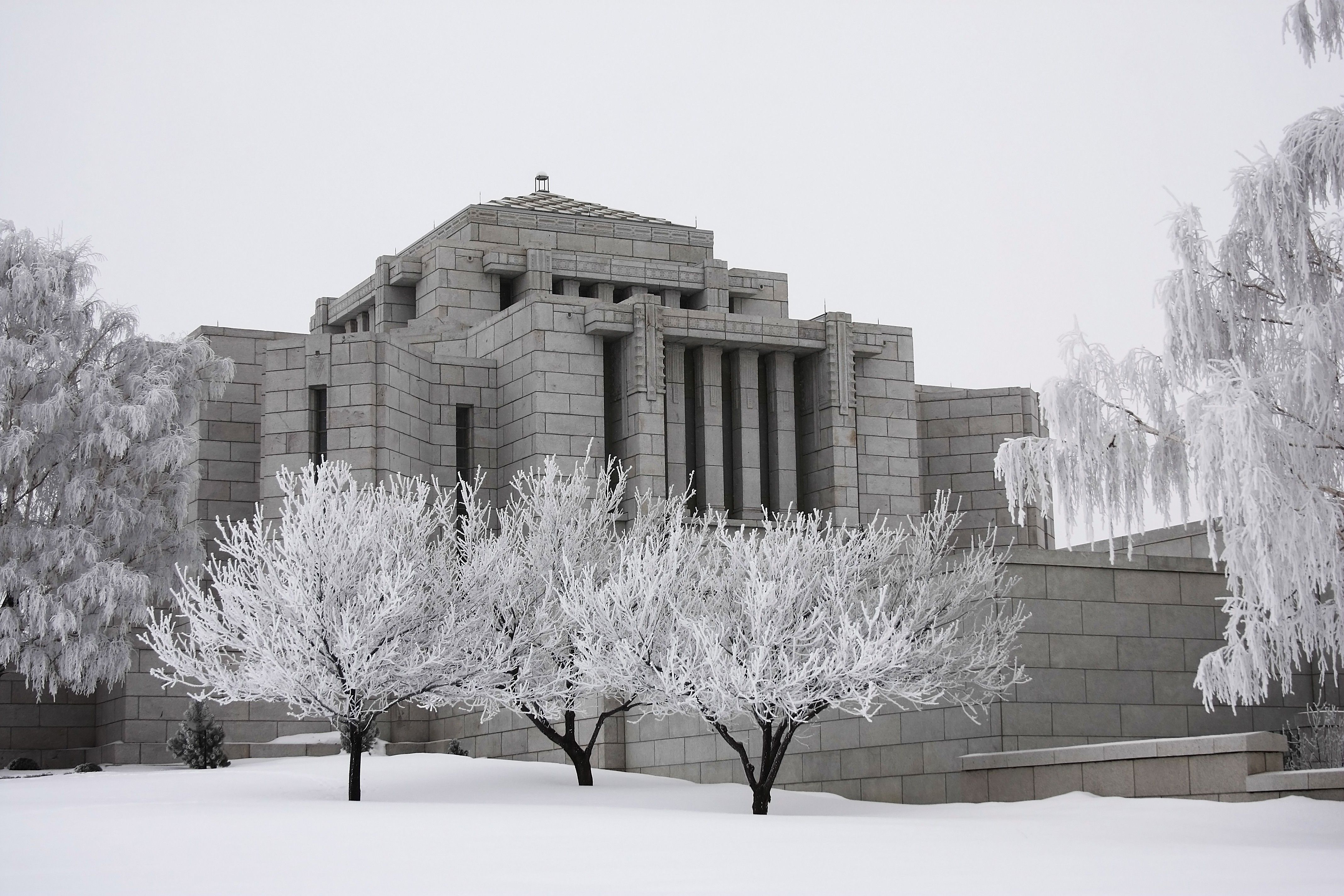 The Cardston Alberta Temple during winter, including the entrance and exterior of the temple.