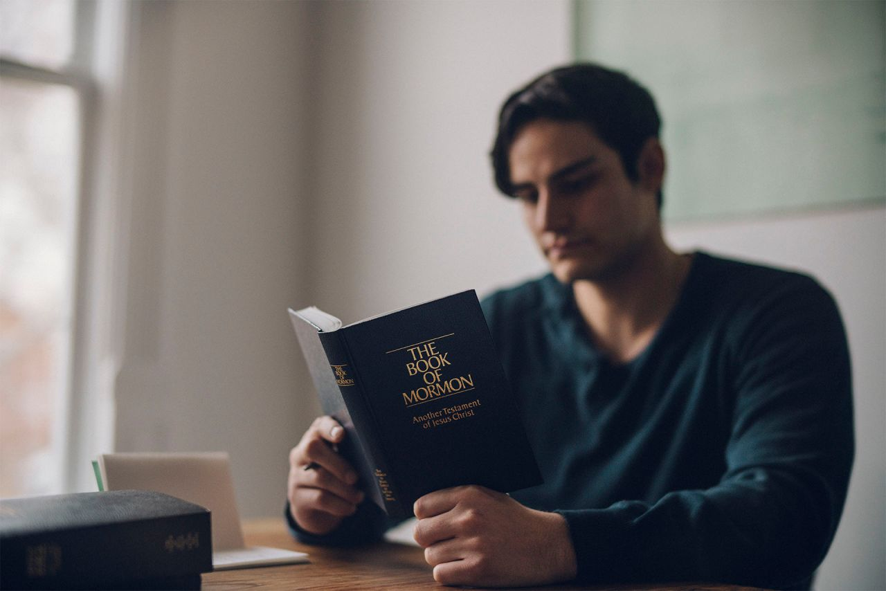 Man reading the Book of Mormon