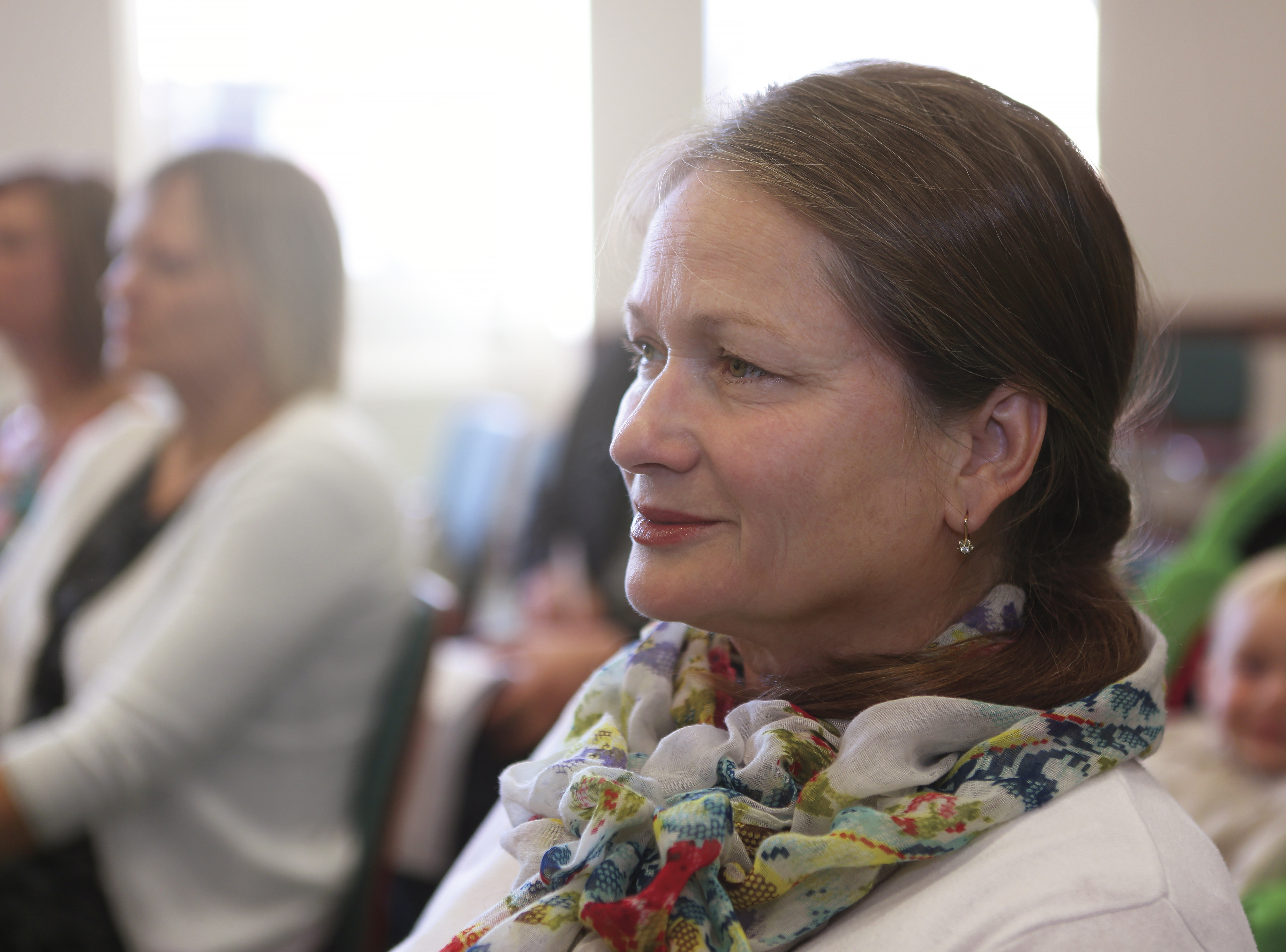 A woman watching general conference in Kyiv, Ukraine.