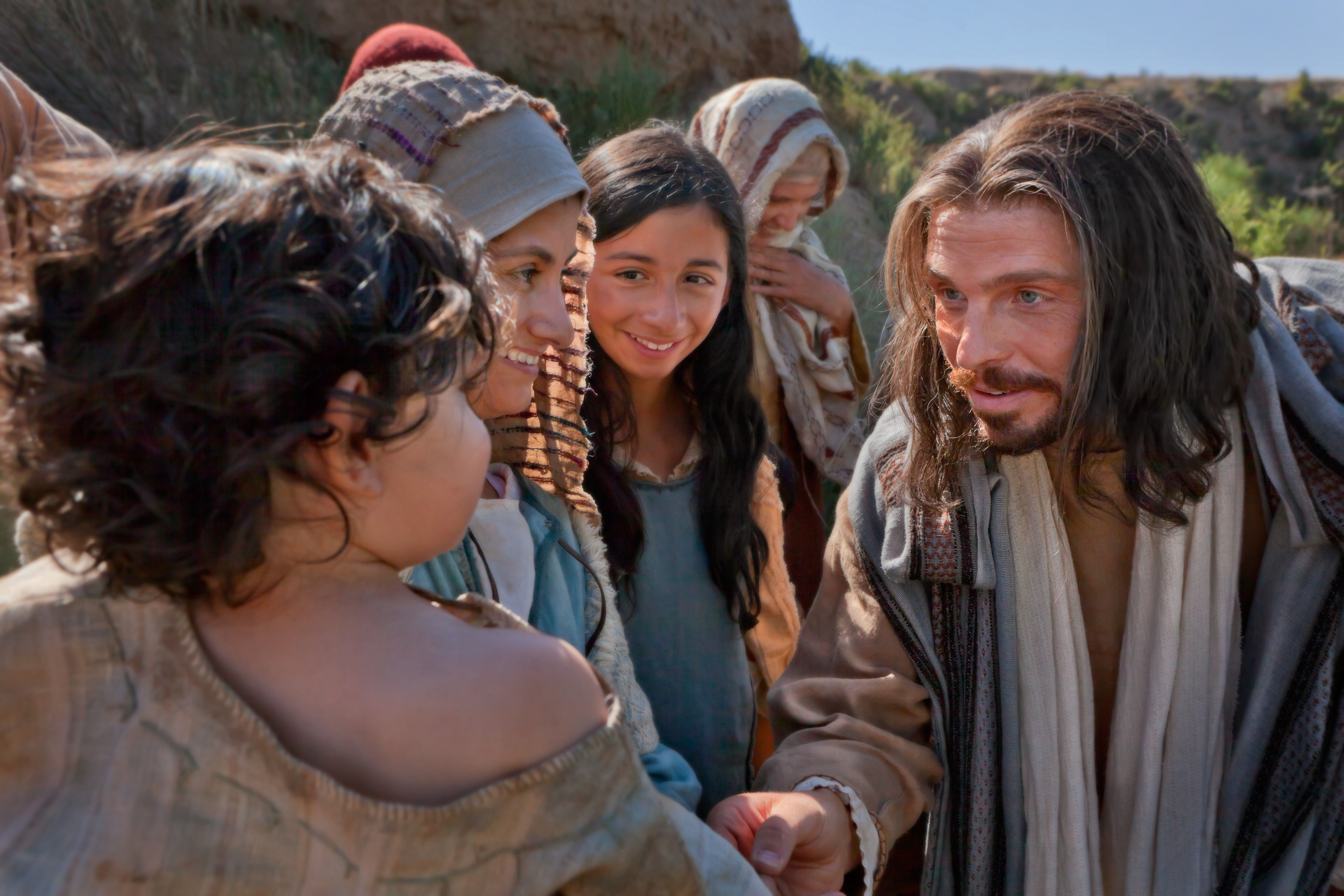 Jesus talking with a child and the child's mother.