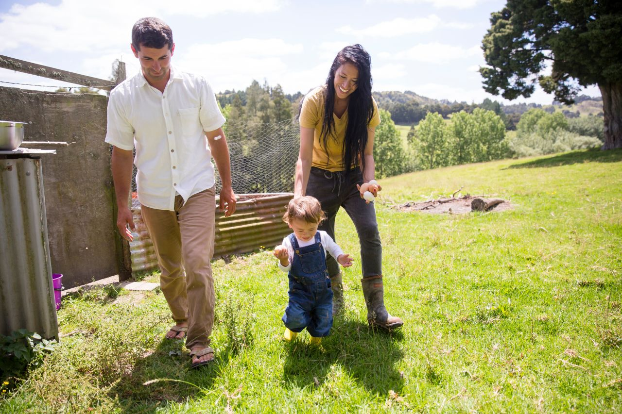 A young couple play with their child spending time with family a good Sabbath activity
