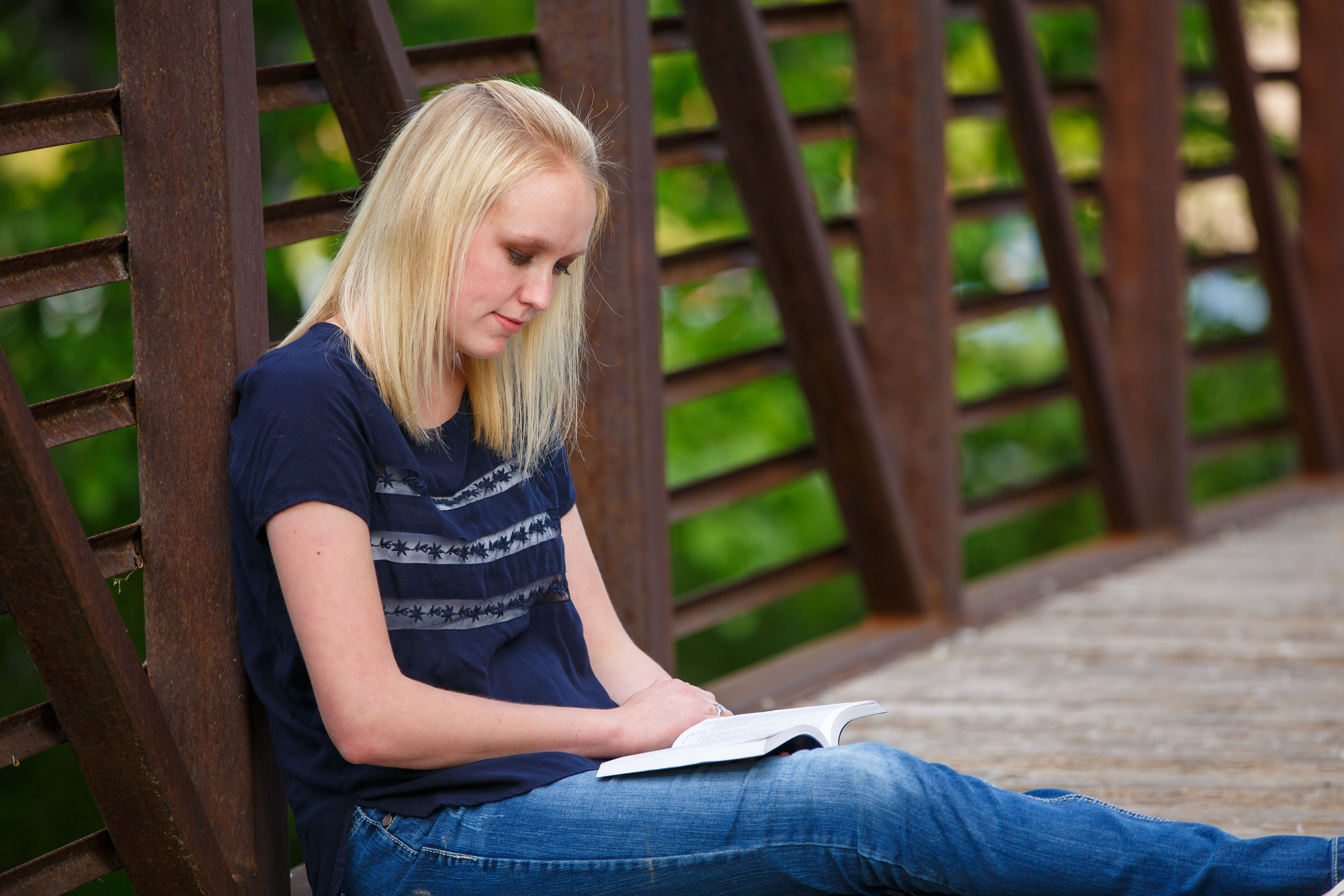 A young woman reading the Book of Mormon.