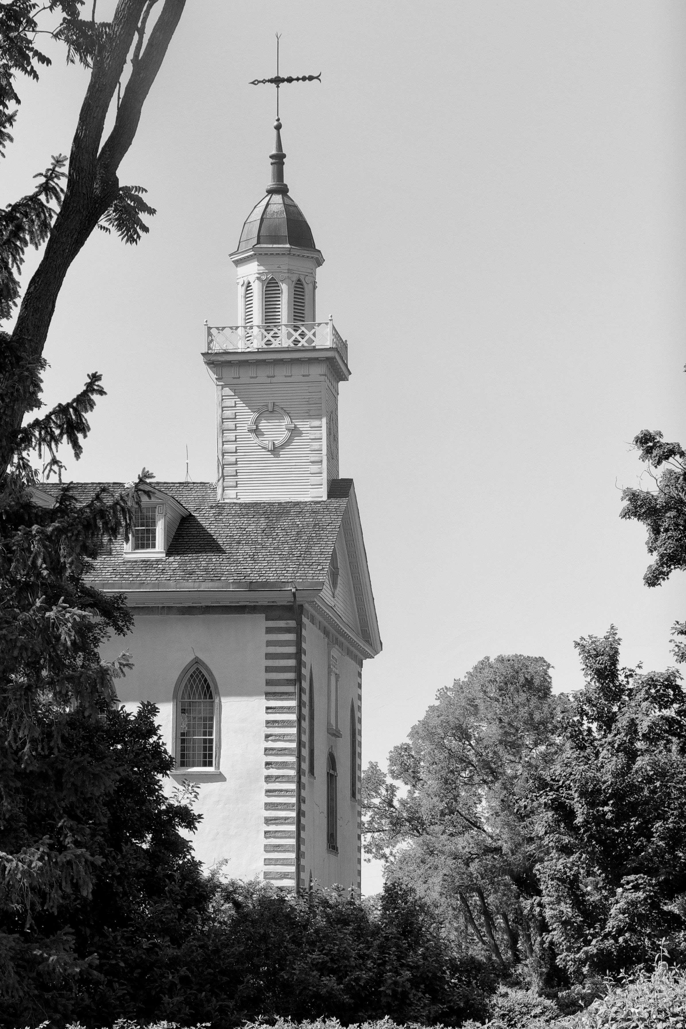 The Kirtland Temple spire in black and white, including scenery.