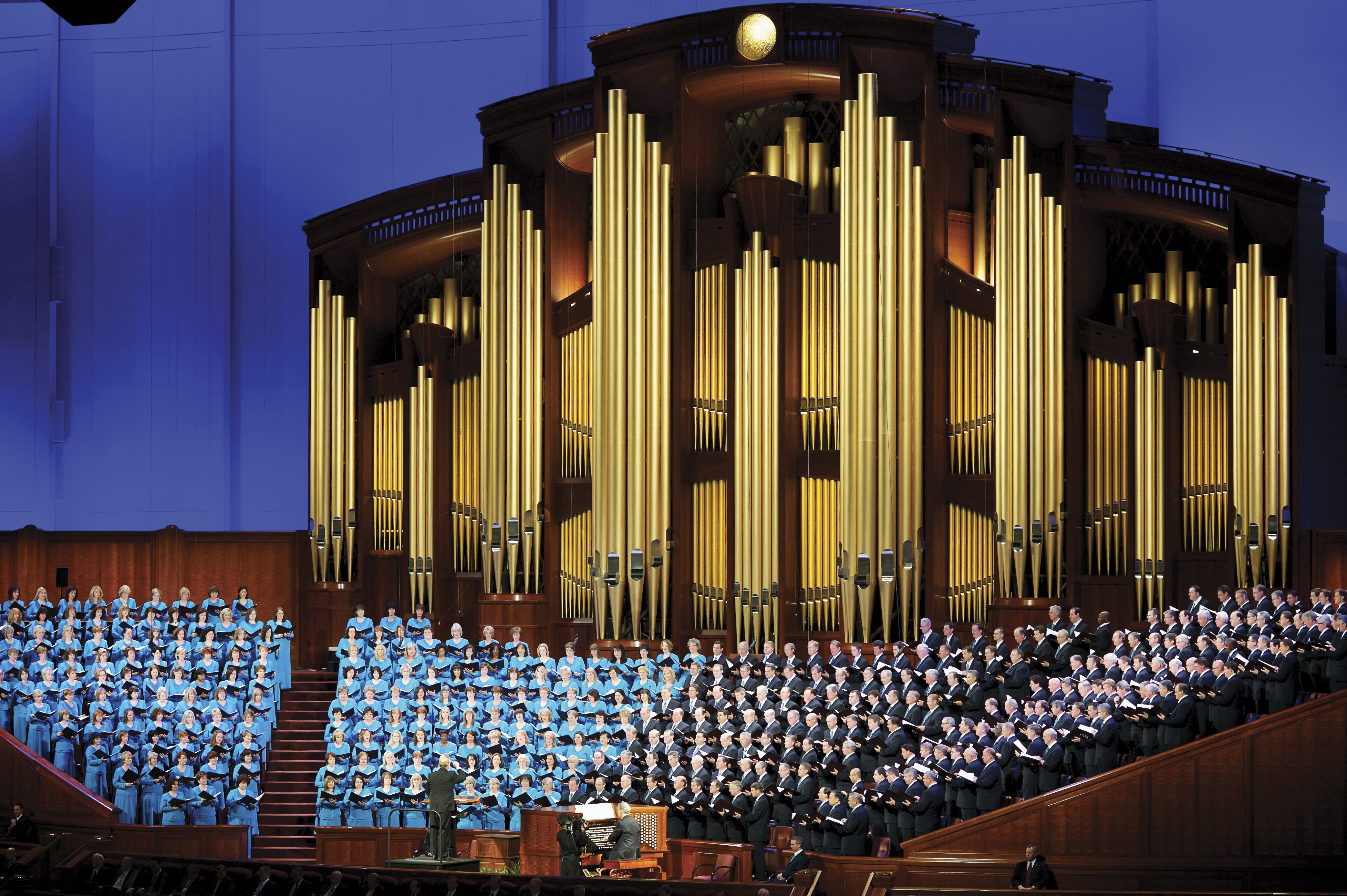 The Mormon Tabernacle Choir standing and singing during a session of general conference.