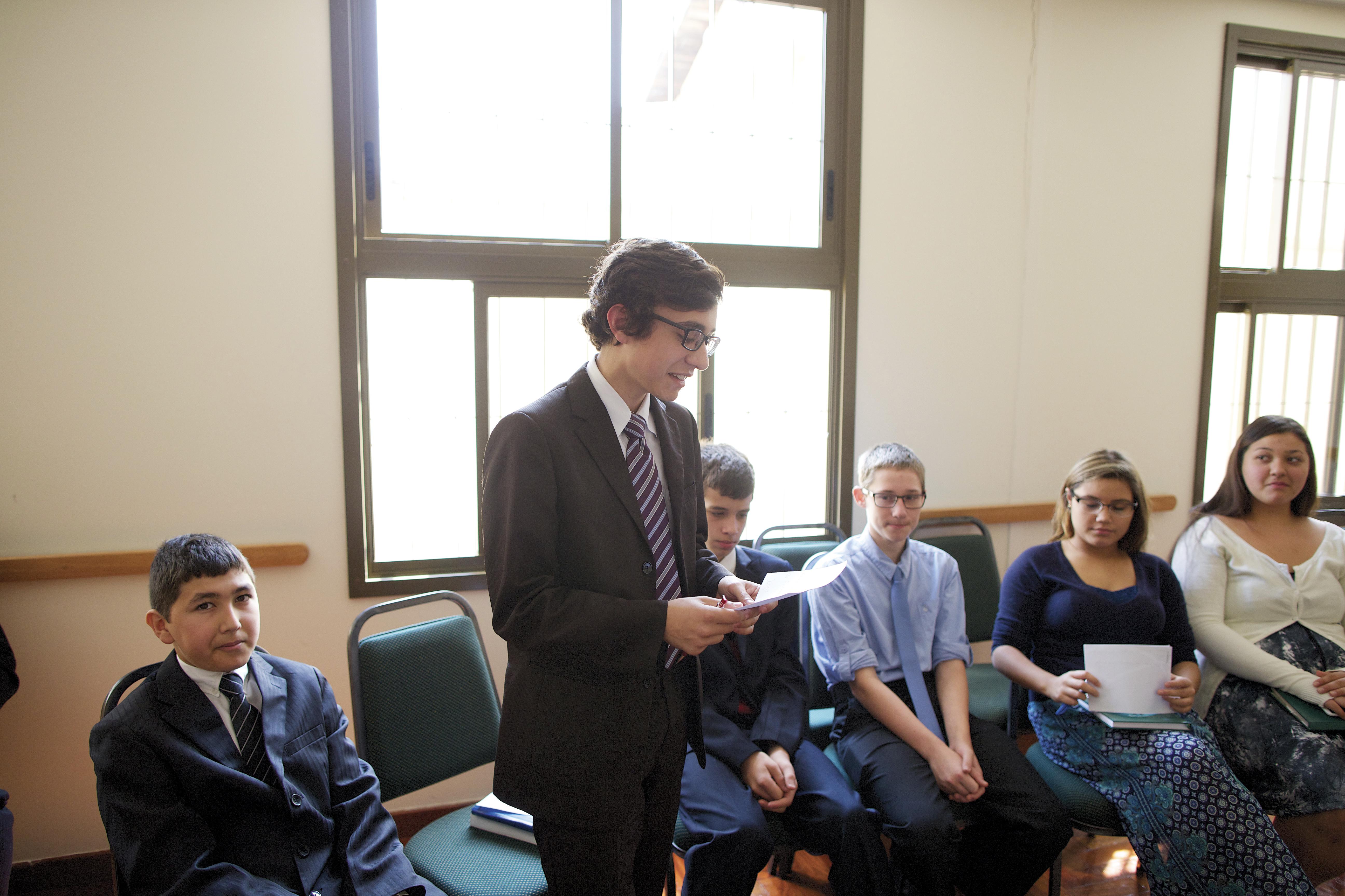 Young women and young men attending a Church class in Brazil.