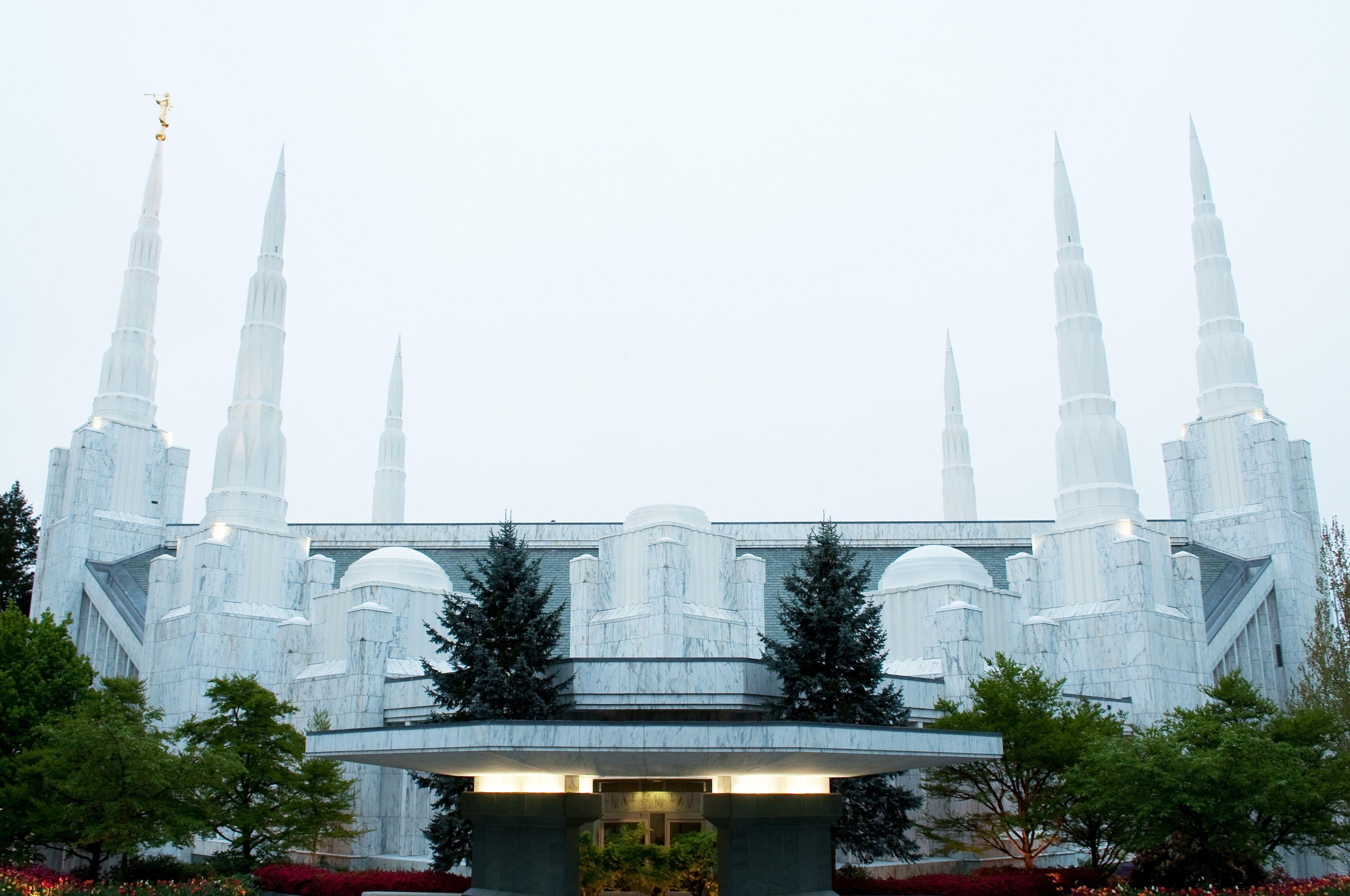 The Portland Oregon Temple and its entrance on a cloudy day.